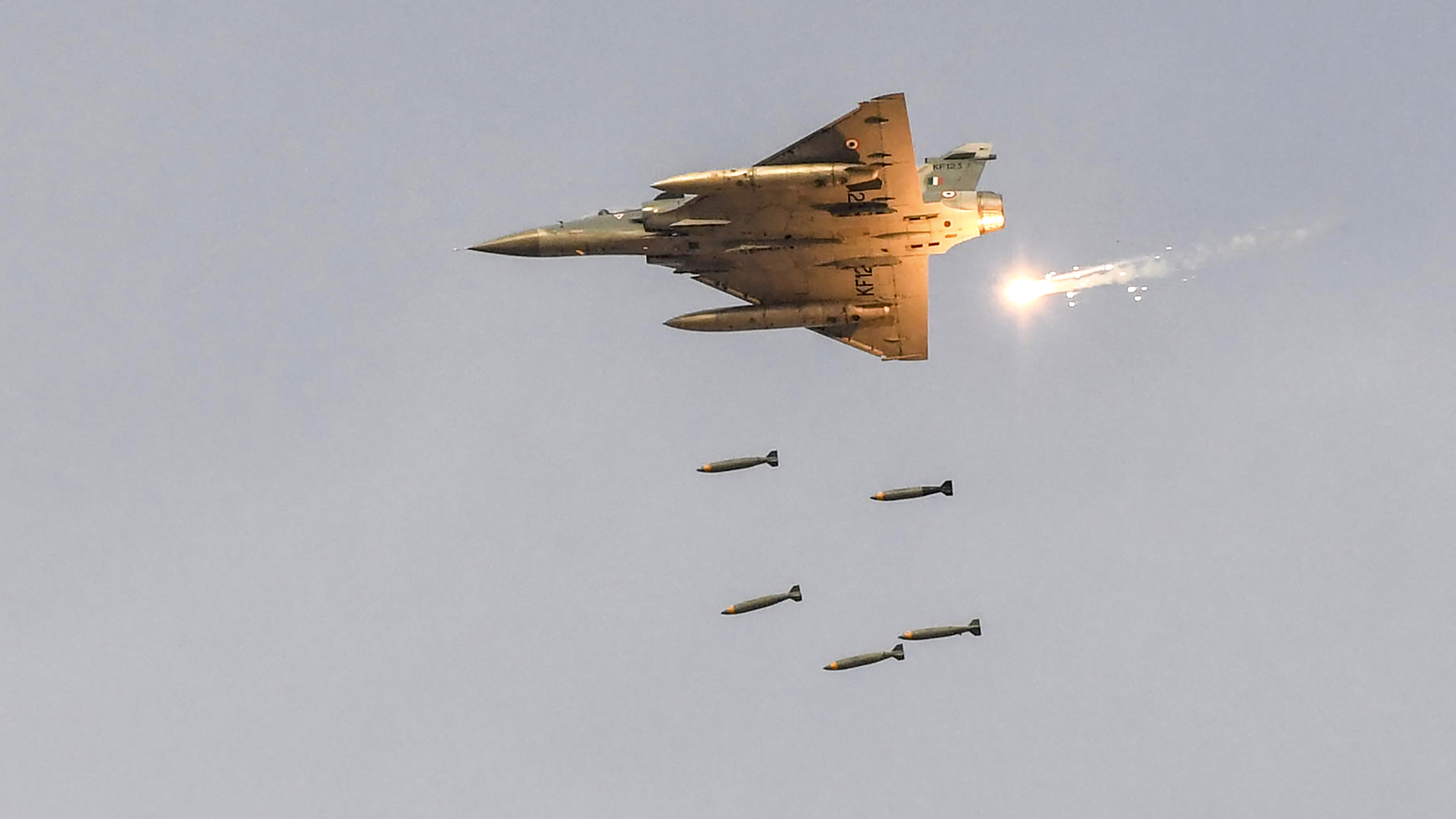 An Indian Air Force (IAF) fighter aircraft drops bombs on dummy targets during the IAF 'Yayu Shakti' fire power demonstration at Pokharan, in the Rajasthan state on February 16, 2019. (PRAKASH SINGH/AFP/Getty Images)