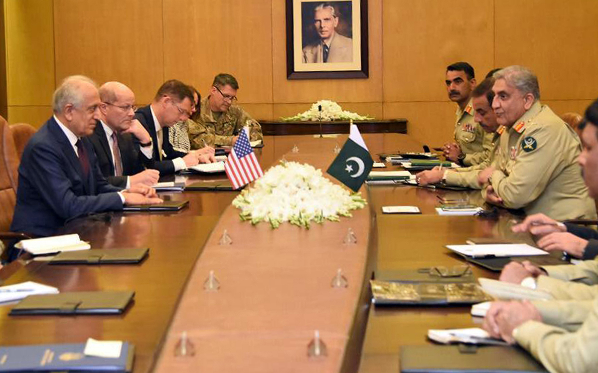 In this photo released by Inter Services Public Relations of Pakistan's military, U.S. peace envoy Zalmay Khalilzad, left, talks with Pakistani Army Chief Gen. Qamar Javed Bajwa, second from right, during a meeting in Rawalpindi, Pakistan, Thursday, Jan. 17, 2019. (Inter Services Public Relations via AP)