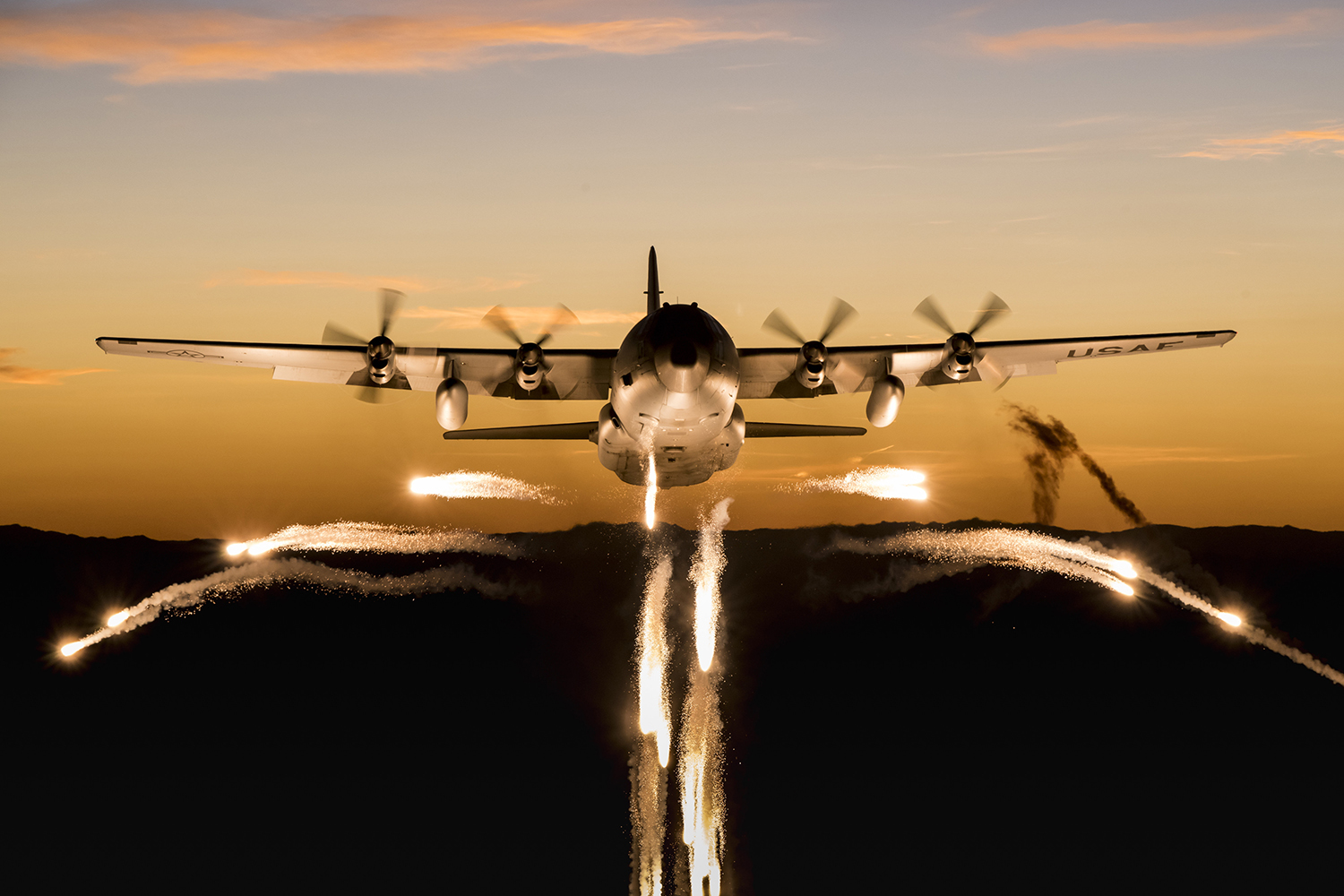 A C-130 Hercules from the Wyoming Air National Guard fires off flares over Camp Guernsey Joint Training Center, Wyo., during a training mission Sept. 24, 2019. (Staff Sgt. Jon Alderman/Air National Guard)