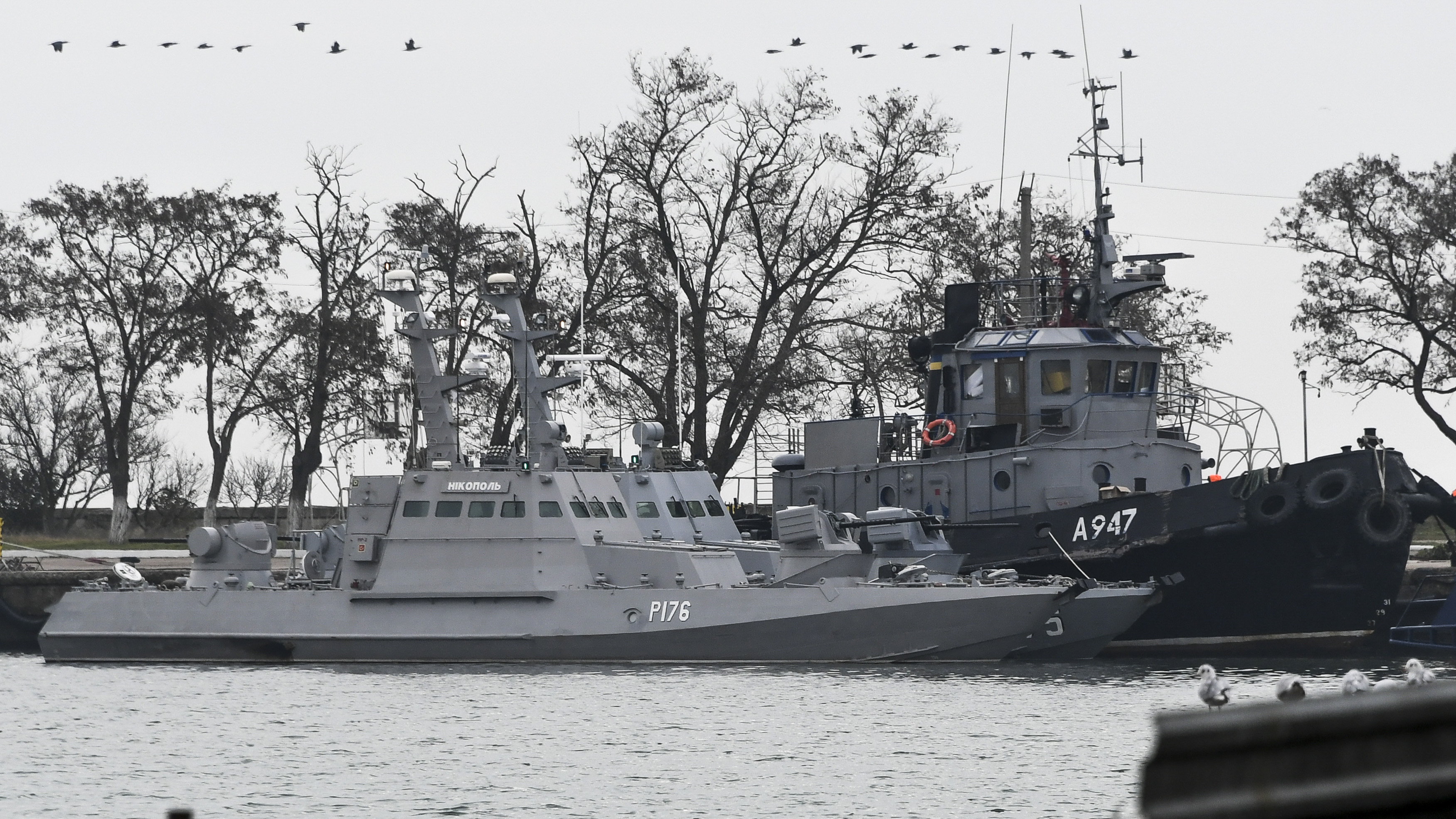 Three Ukrainian naval ships are seen at dock the day after being seized by Russian forces on Sunday, Nov. 25, 2018, in Kerch, Crimea, The Ukrainian parliament is set to consider a presidential request for the introduction of martial law in Ukraine following an incident in which Russian coast guard ships fired on the two Ukrainian navy gunboats and tugboat. (AP Photo)