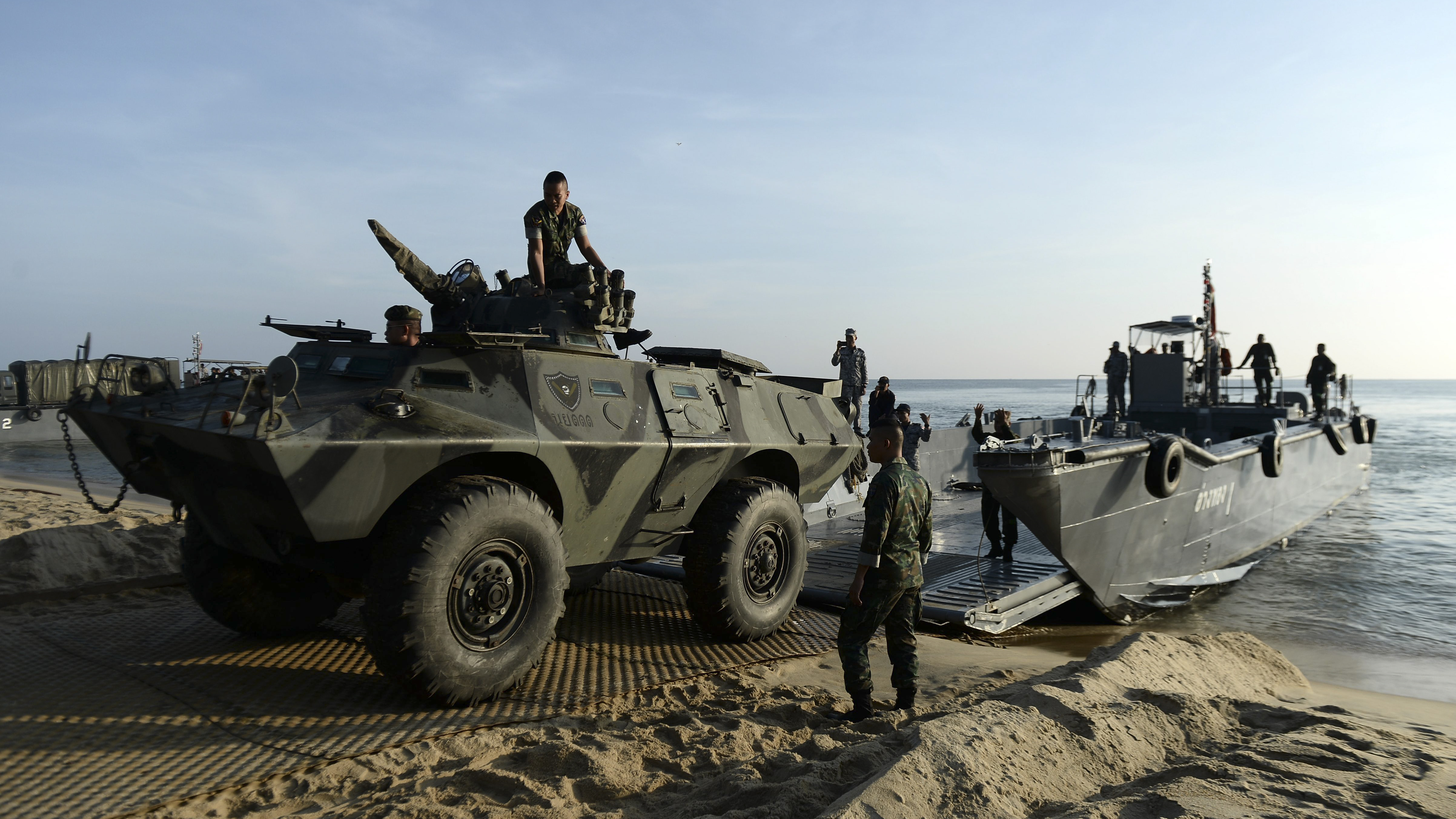 Thai Marines unload army vehicles from a sea vessel as units change shifts to patrol the coast along the southern Thai province of Narathiwat, near the Malaysian border, on September 29, 2018. (MADAREE TOHLALA/AFP/Getty Images)