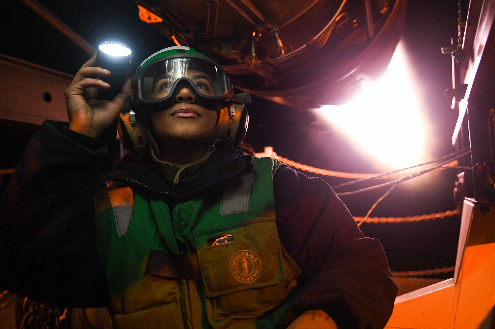 Aviation Machinist's Mate Airman Jadah Martinez inspects an after burner for fuel leaks Oct. 26, 2018, during an active test on the fantail aboard the Nimitz-class aircraft carrier USS Harry S. Truman (CVN 75) in the Norwegian Sea. (MC3 Victoria Granado/Navy)