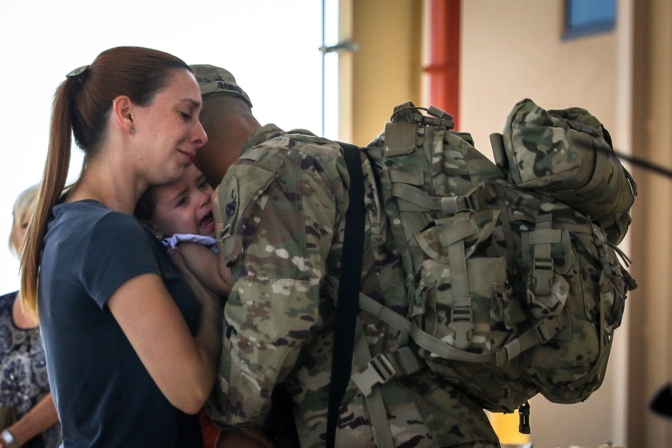 Spc. Eduardo Toro hugs his family as he prepares to depart Fort Bliss, Texas, Aug. 1, as part of a deployment to Afghanistan. (Spc. Matthew J. Marcellus/Army)