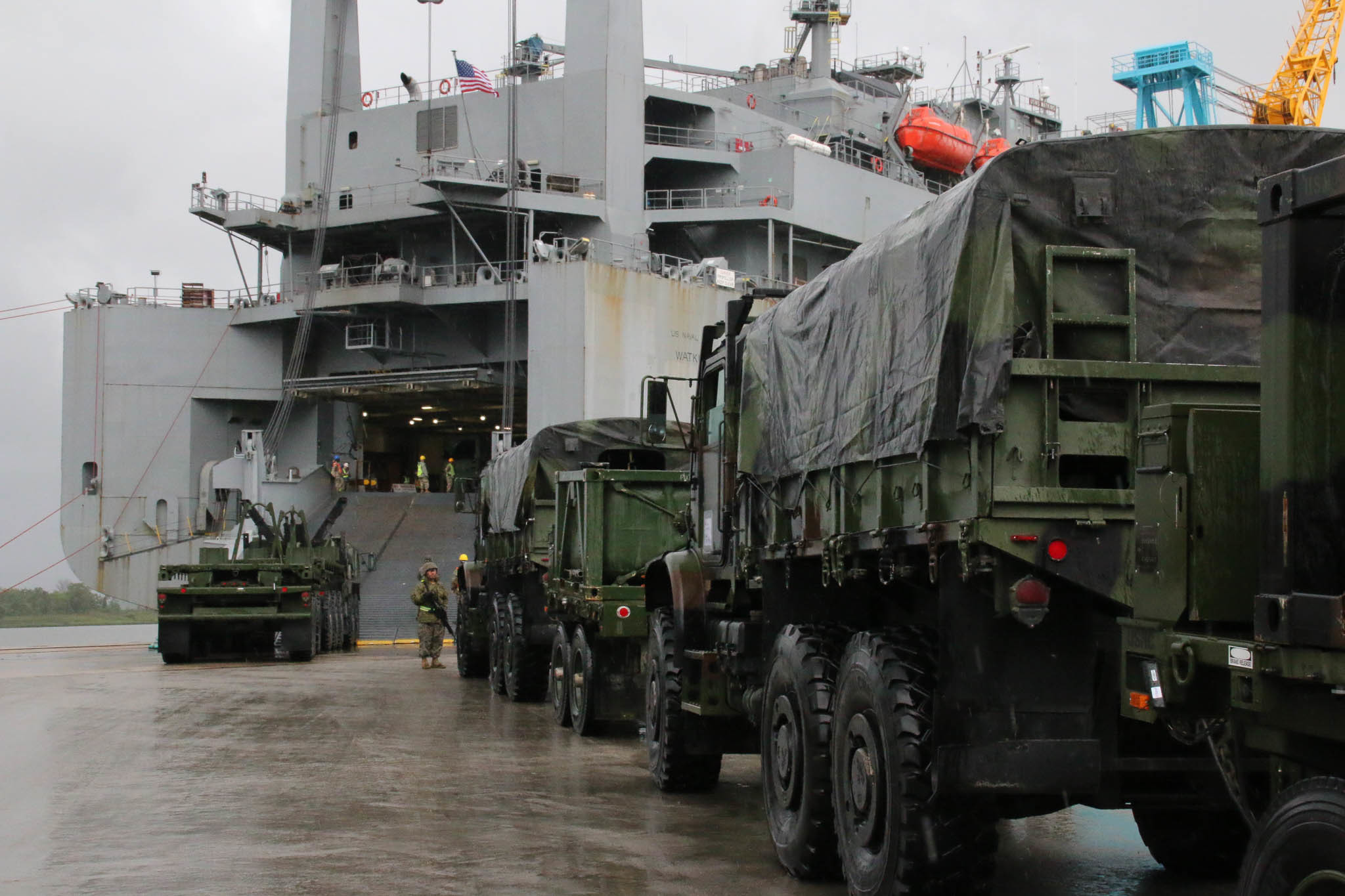 Soldiers and Marines load equipment aboard the USNS Watkins in preparation for Resolute Sun 2019's joint logistics over-the-shore scenario outside of Norfolk, Va. (Steven J. Mirrer/U.S. Army)