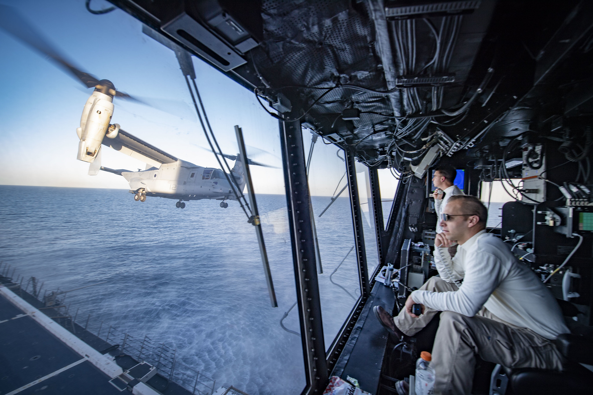 Lt. Cmdr. Brooks Rogers, the air boss aboard the amphibious transport dock ship USS Portland (LPD 27), watches flight operations Feb. 11, 2020, as an MV-22B Osprey takes off from Portland's flight deck to simulate an air assault on Camp Pendleton, Calif., during Exercise Iron Fist 2020. (Mass Communication Specialist 2nd Class Jessica Paulauskas/Navy)