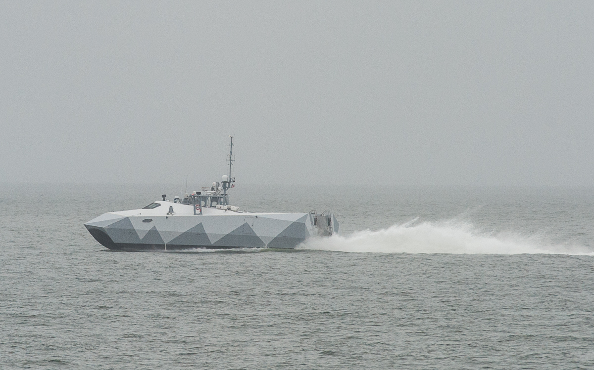 Norfolk, Va. (April 2, 2017) The Navy's cool looking M80 Stiletto test-bed ship speeds through the Chesapeake Bay towards Hampton Roads on April 3 . Capable of speeds of up to 60 knots, the craft was designed to take Navy SEALs to battle, but has ended up testing the coolest new toys the Navy is considering buying. The ship is preparing for a trip to Washington, D.C. for the annual Sea, Air and Space Symposium that starts April 11. (photo by Mark D. Faram/staff)