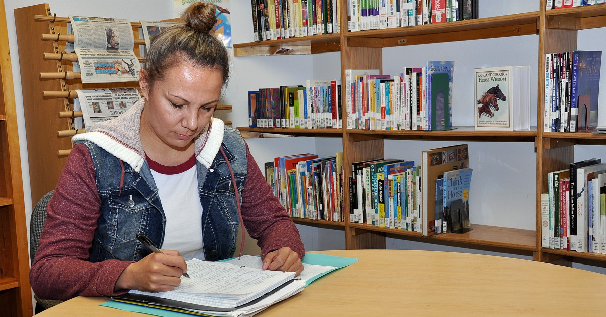 Spc. Tatiana Lafferty, a carpentry masonry specialist with the South Dakota Army National Guard, studies for an English class at Oglala Lakota College. (Staff Sgt. Austin Pearce/Army)