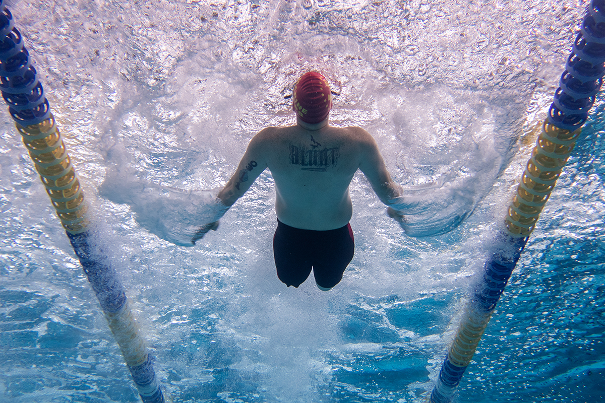 Marine Corps veteran Pfc. Isaac Blunt competes in the 50 meter backstroke on June 29 using his own unique swim technique during the 2019 DoD Warrior Games. (Master Sgt. David Long/Air Force)