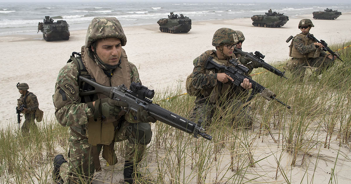 U.S. Marines take a part in a landing operation during a military Exercise Baltops 2018 at the Baltic Sea near village Nemirseta in Klaipeda district, some 340 kms (211 miles) west north of the capital Vilnius, Lithuania. Lithuania, Monday, June 4, 2018. A major U.S.-led military exercise with 18,000 soldiers from 19 primarily NATO countries has kicked off in the alliance's eastern flank involving Poland and the three Baltic states of Estonia, Latvia, Lithuania. (AP Photo/Mindaugas Kulbis)