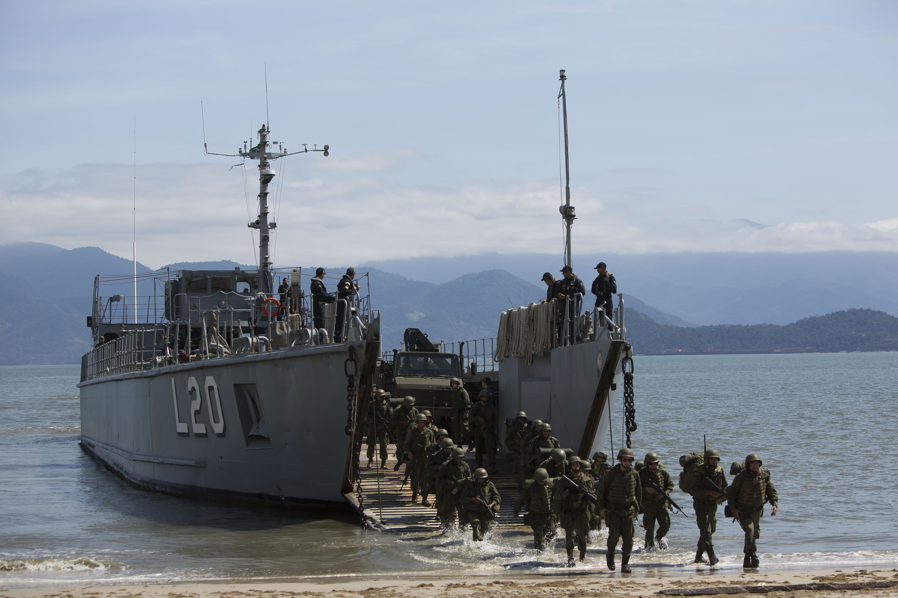Members of the Brazilian Navy disembark on Marambaia Island, during an UNITAS multinational naval exercise in Rio de Janeiro, Brazil, Tuesday, Aug. 27, 2019. From Aug. 19 to 30, naval forces from Brazil, Chile, Argentina, Colombia, Ecuador, Panama, Paraguay, Peru, Mexico, United Kingdom and the United States, will take part in UNITAS LX 2019, an annual multinational maritime exercise. (AP Photo/Bruna Prado)