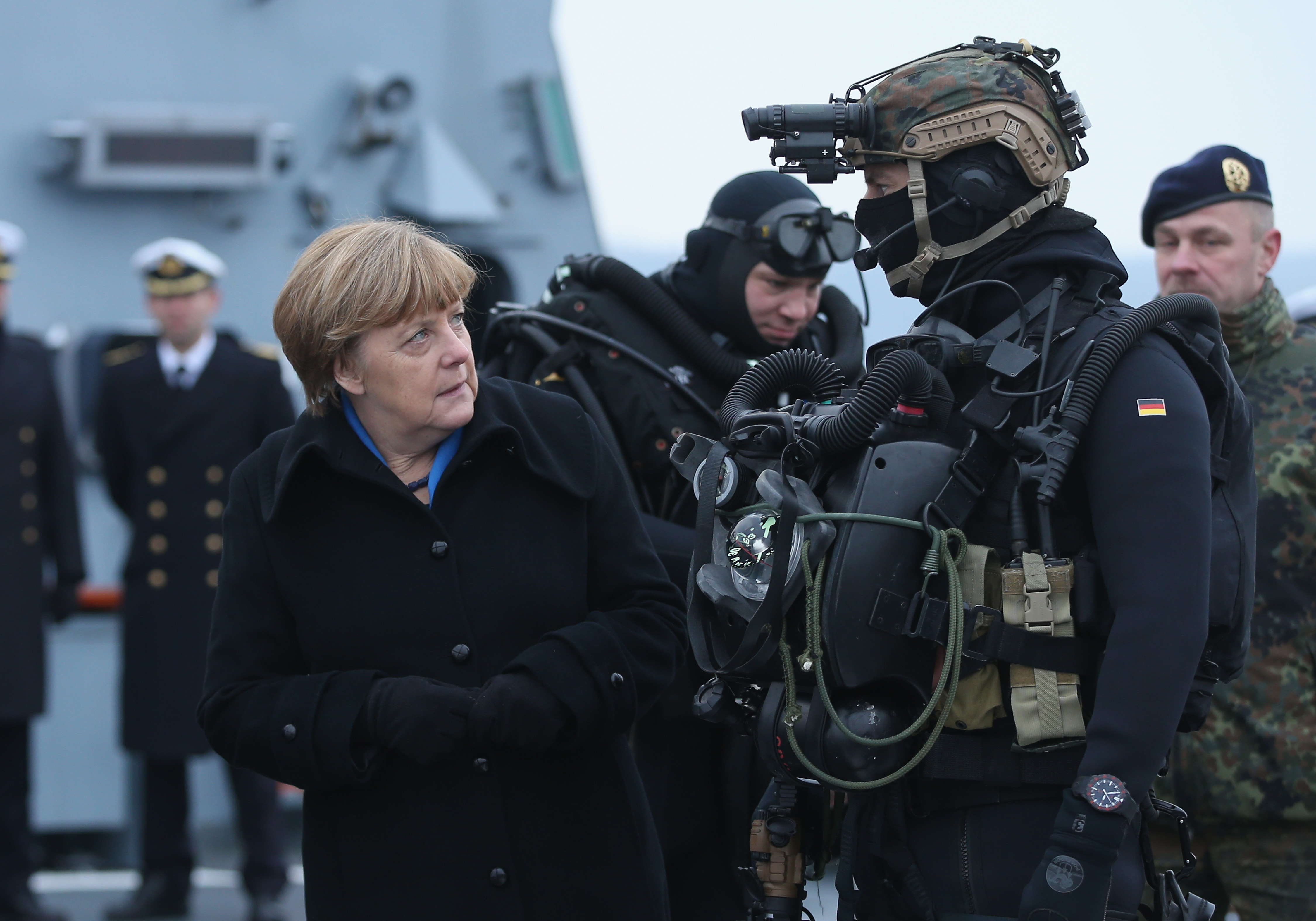 German Chancellor Angela Merkel inspects a member of the German Navy's Special Forces divers' unit while she visited the