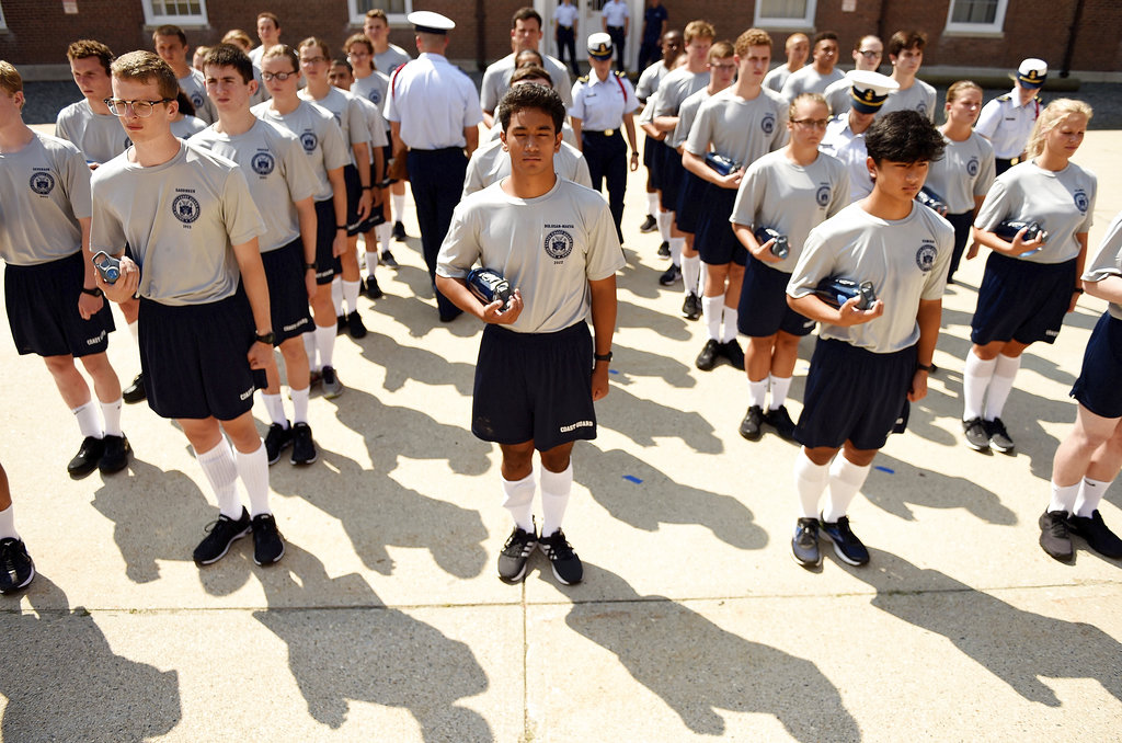 Whiskey One company practices formation with their cadre as the U.S. Coast Guard Academy Class of 2022 reports-in for Day 1 of Swab Summer on July 2, 2018, at the academy in New London, Conn. (Sean D. Elliot/The Day via AP)