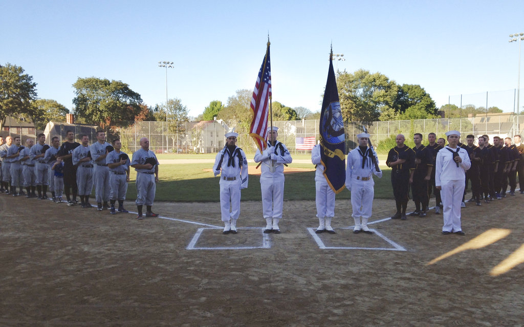U.S. Naval War College students salute the flag before an Army versus Navy baseball game Friday, Sept. 29, 2017, in Newport, R.I. The war college recognized the centennial of America's involvement in World War I by recreating the U.S. Army versus Navy games from that era. (Jennifer McDermott/AP)