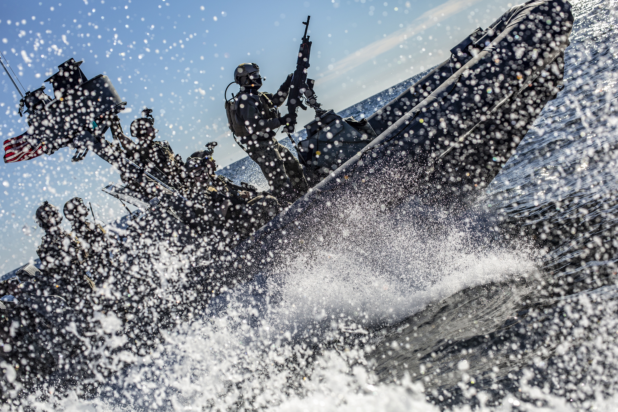 Marines and sailors with the 11th MEU ride in a rigid-hull inflatable boat during a visit, board, search and seizure exercise Feb. 24, 2019, in the Pacific. (Cpl. Matthew Teutsch//Marine Corps)