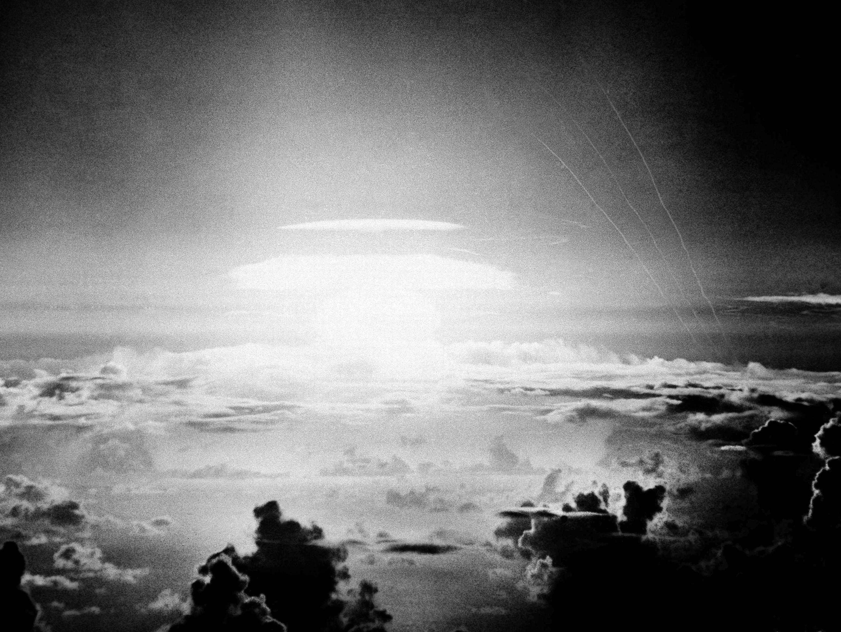 In this May 21, 1956, photo, the fireball of a hydrogen bomb lights the Pacific sky a few seconds after the bomb was released over Bikini Atoll. A decade earlier, the island chain became known as a nuclear test site thanks to atom bombs designed to destroy naval fleets. (AP)