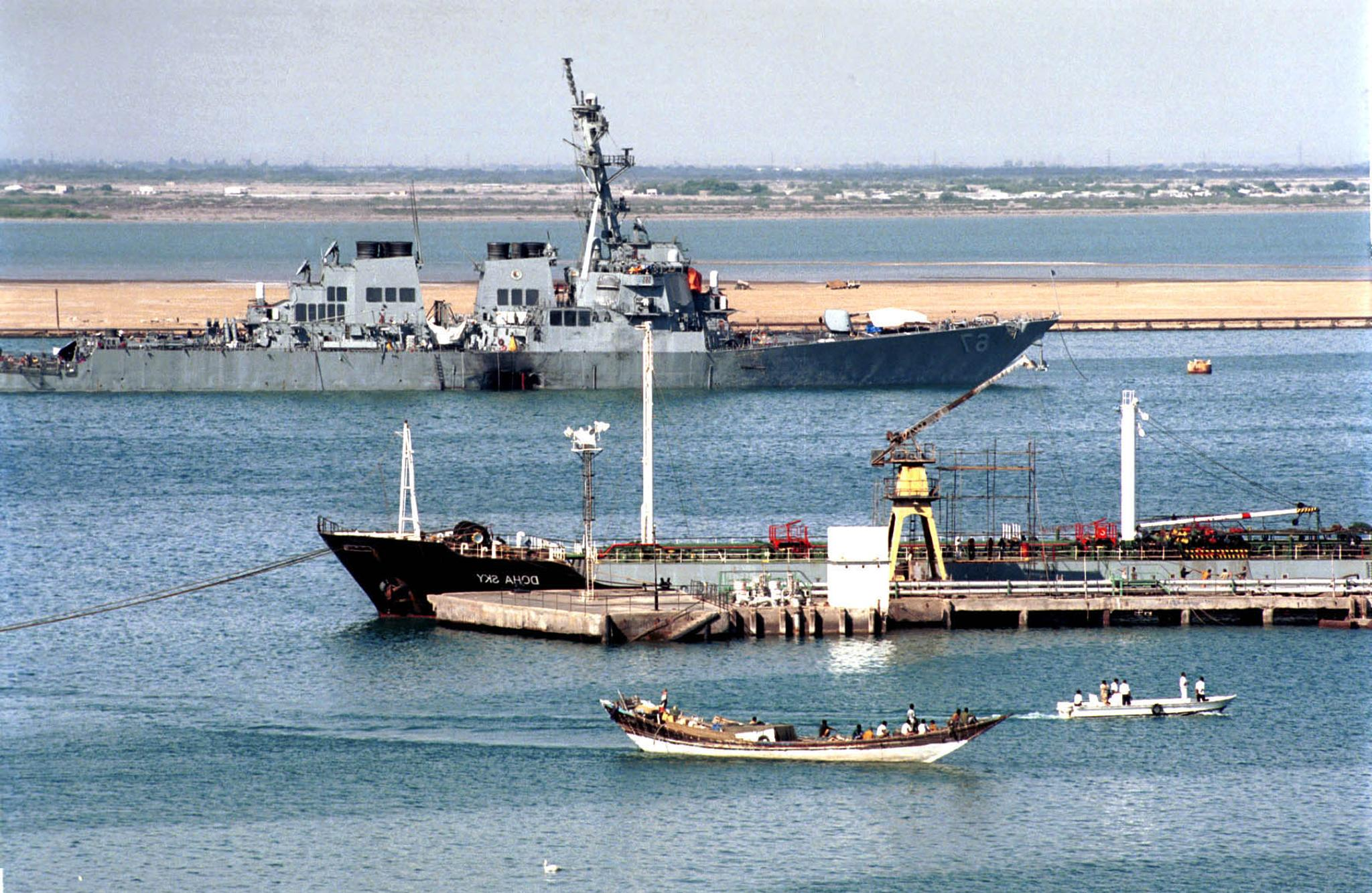 ADEN, YEMEN: Official US investigators patrol the area around the USS Cole destroyer at Aden harbour in southern Yemen 20 October 2000. The New York Times said the United States received two warnings about possible terrorist attacks against US targets in late May and mid-September, well ahead of the October 12 bombing of the US warship in Yemen. (KHALED FAZAA/AFP/Getty Images)