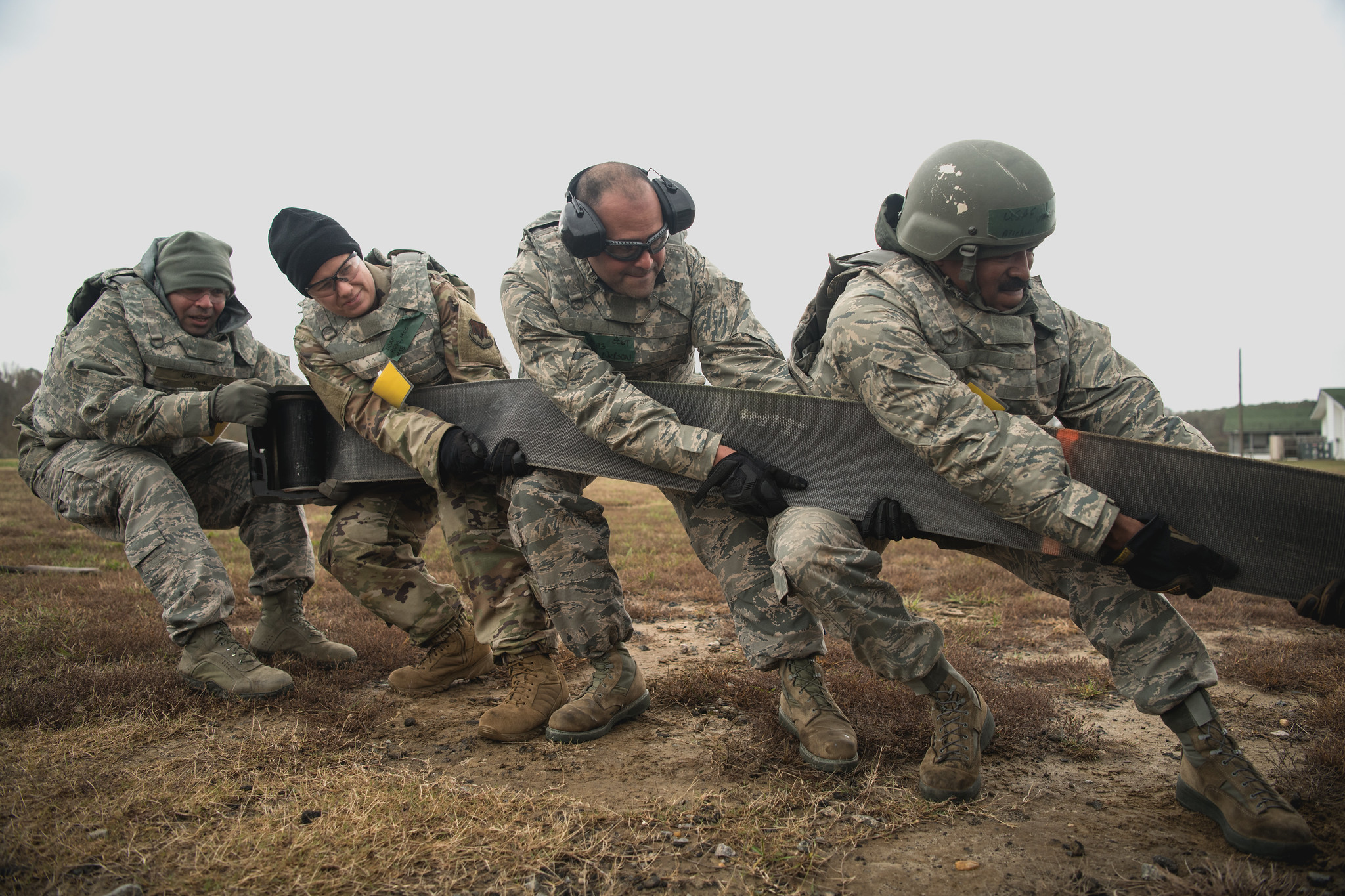 Airmen assigned to the 203rd RED HORSE Squadron, Virginia Air National Guard set up a mobile aircraft arresting cable during a four-day field training exercise on Nov. 16, 2019. (Senior Airman Bryan Myhr/Air National Guard)