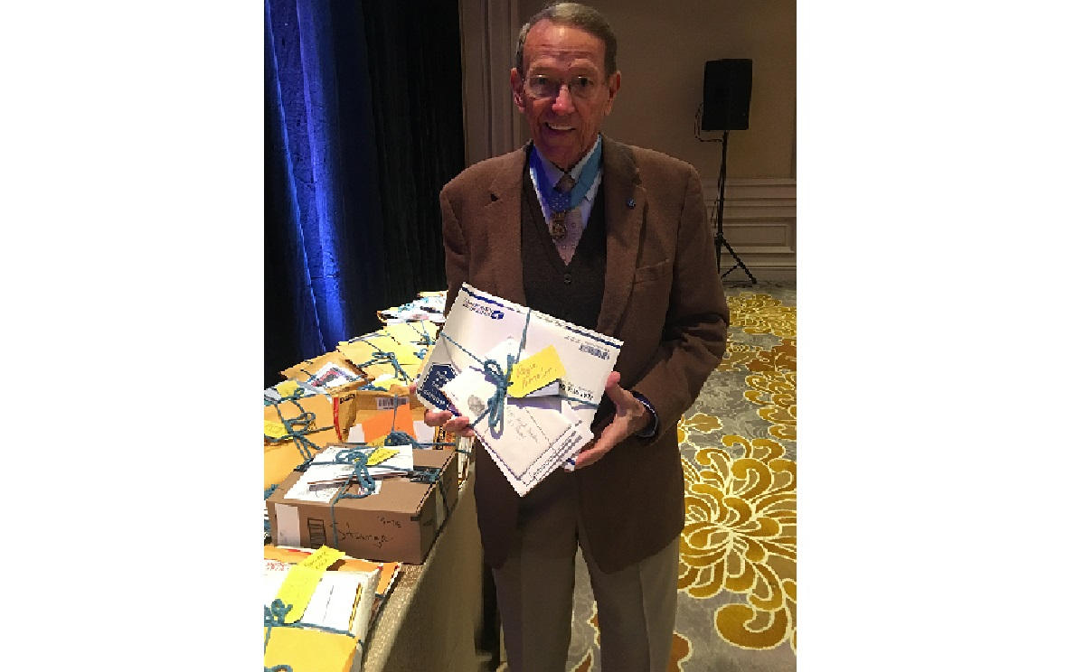 Roger Donlon shows off some of the mail he received at a luncheon honoring Medal of Honor recipients March 22. Donlon, the first man to receive the Medal of Honor for service during the Vietnam War, also was the first-ever Special Forces soldier honored with the award. (Courtesy of Janine Stange)