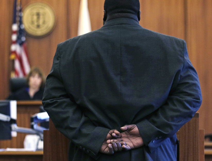 A former U.S. Marine stands before Associate Judge Pamela Woodcock Pfeiffer during a session of a veterans court at the Kent County Courthouse in Warwick, R.I., on May 13, 2016. On Monday, the president signed into law an expansion of the Department of Veterans Affairs Veterans Justice Outreach program. (Charles Krupa/AP)