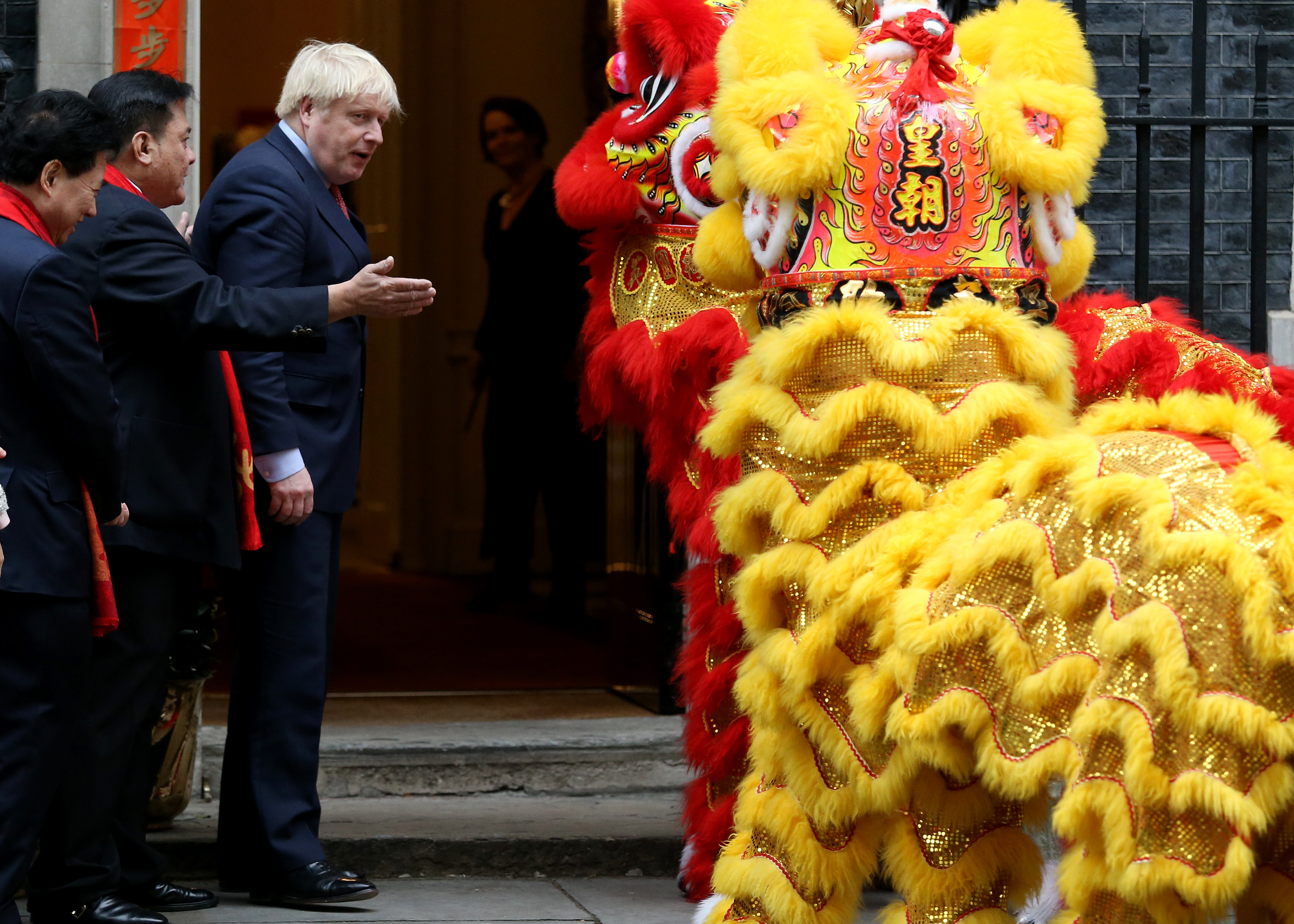 U.K. Prime Minister Boris Johnson speaks with guests as he hosts Chinese New Year celebrations outside 10 Downing Street on January 24, 2020, in London, England. In a potential rebuke to the Trump administration, the U.K. is reportedly expected to grant Chinese telecom giant Huawei some access to its nascent 5G network. (Lauren Hurley/Getty Images)