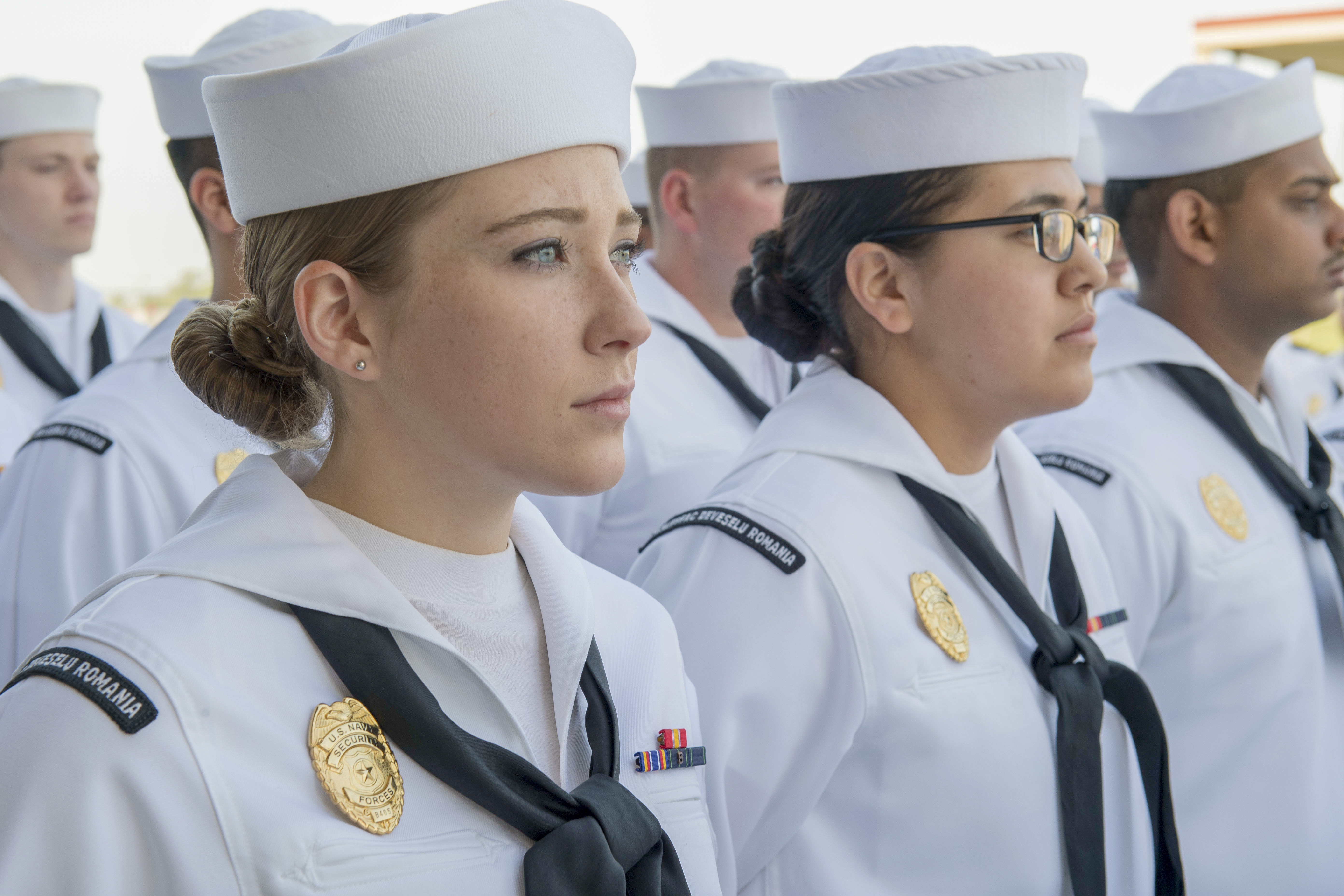 Sailors at Naval Support Facility (NSF) Deveselu, Romania, stand in formation for a dress white uniform inspection May 1, 2018. NSF Deveselu and AAMDS Romania are co-located with the Romanian 99th Military Base and play a key role in ballistic missile defense in Eastern Europe. (U.S. MC1 Jeremy Starr/Navy)