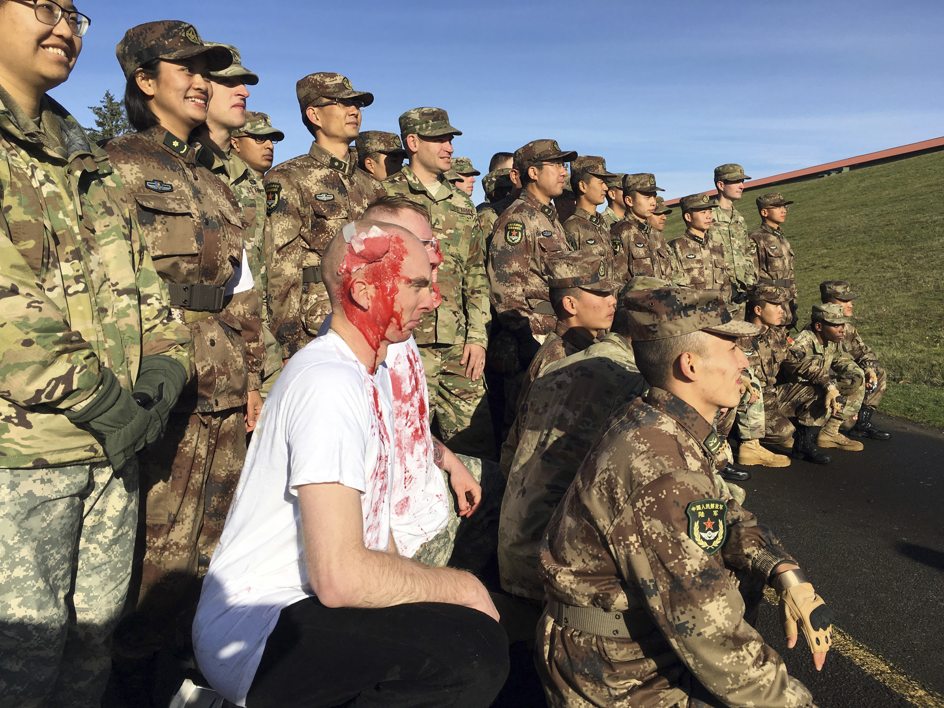 Soldiers from the U.S. and China pause during a joint disaster-response drill at Camp Rilea Armed Forces Training Center near Warrenton, Ore. on Nov. 18. It was only a drill, but roughly 100 soldiers from China and the U.S. and their top commanders are ready to use what they learned in a real disaster. (Andrew Selsky/AP Photo)