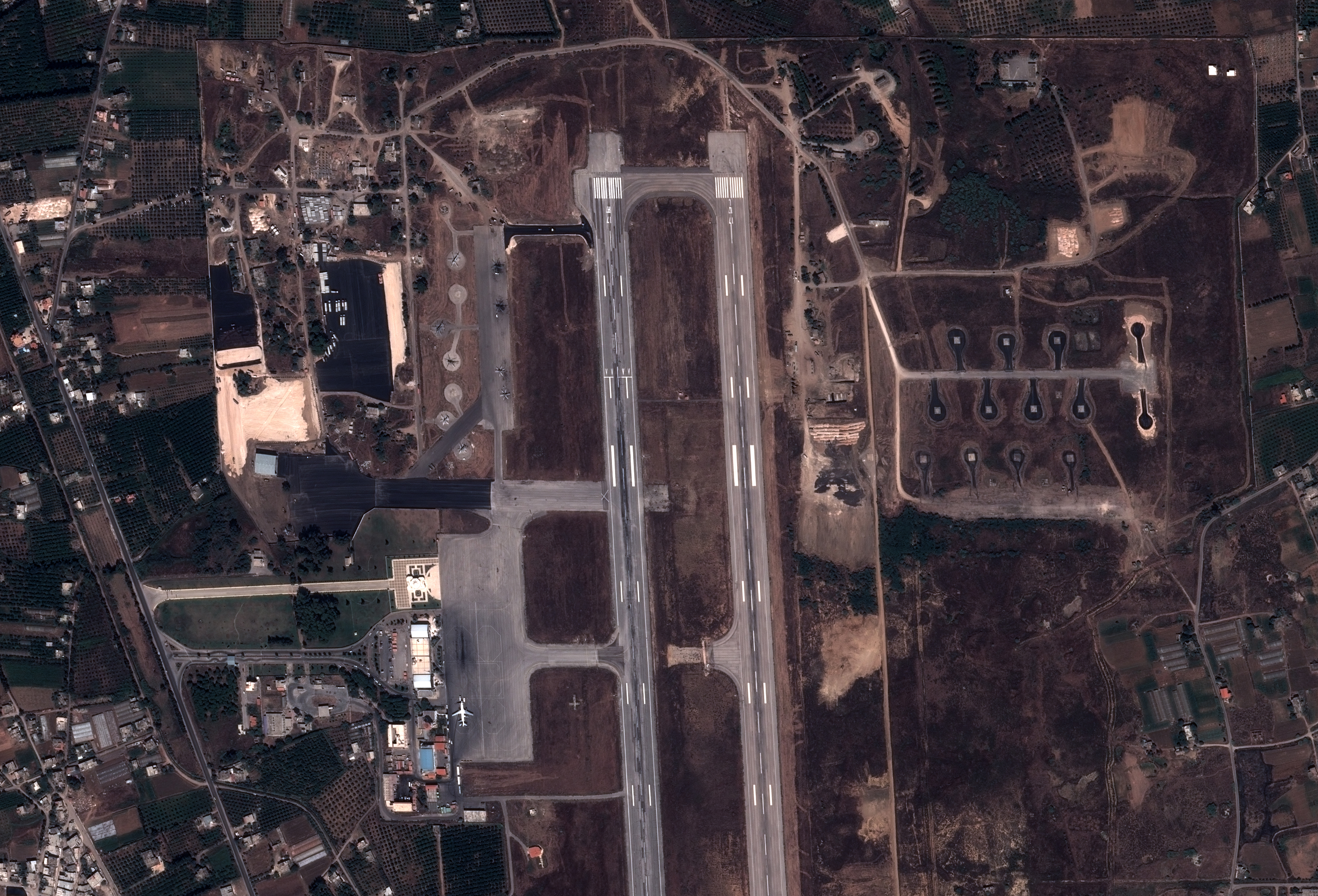 An image by Pleiades Satellite shows a view of a military base in the government-controlled coastal Syrian city of Latakia. (AFP photo)