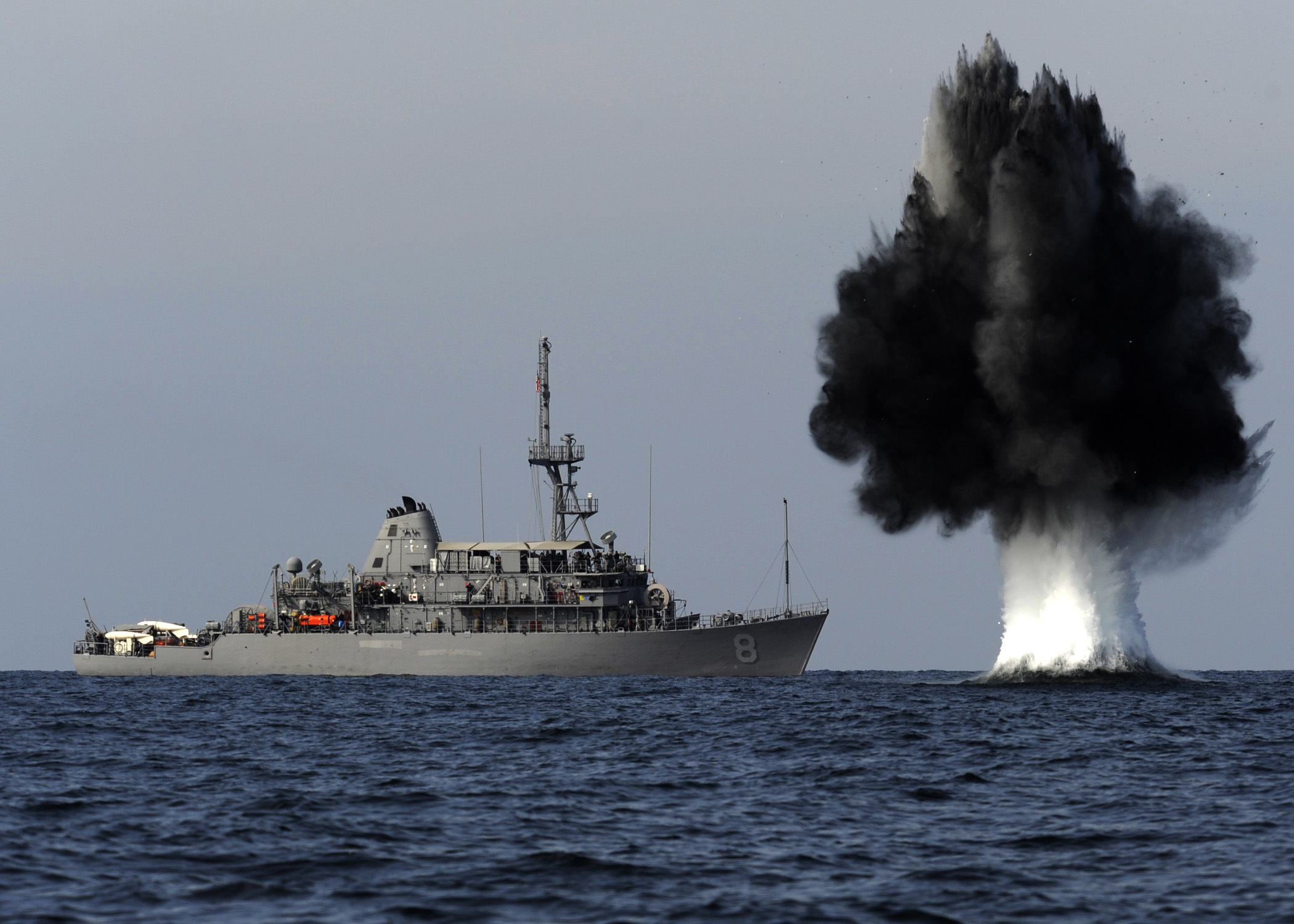 A demolition charge detonates 1,500 meters from the Avenger-class mine countermeasures ship Scout. (MC1 Joshua Lee Kelsey/U.S. Navy)