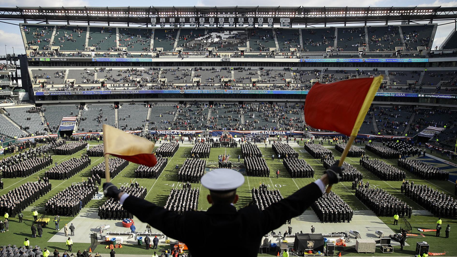 Navy Midshipman Frey Pankratz singles his classmates as they march onto the field ahead of an NCAA college football against the Army, Saturday, Dec. 8, 2018, in Philadelphia. (AP Photo/Matt Rourke)