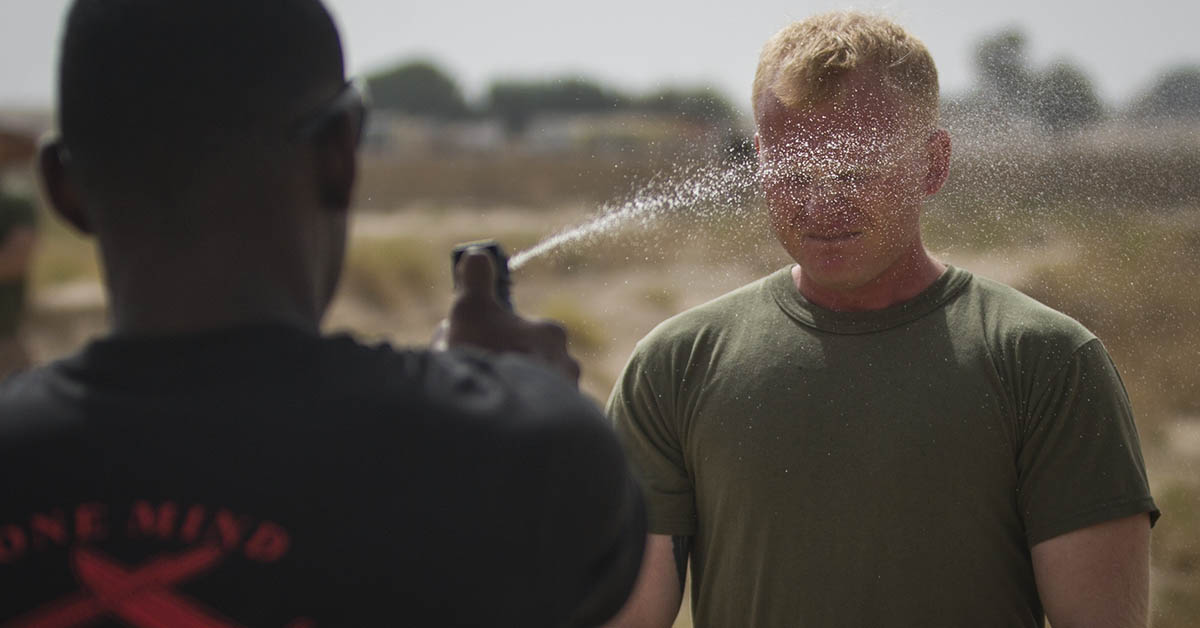 Staff Sgt. Jack Latham, a platoon sergeant with India Company, 3rd Battalion 7th Marines, attached to Special Purpose Marine Air-Ground Task Force, Crisis Response-Central Command, is sprayed with Oleoresin Capsicum during a non-lethal weapons course. (Cpl. Teagan Fredericks/Marine Corps)