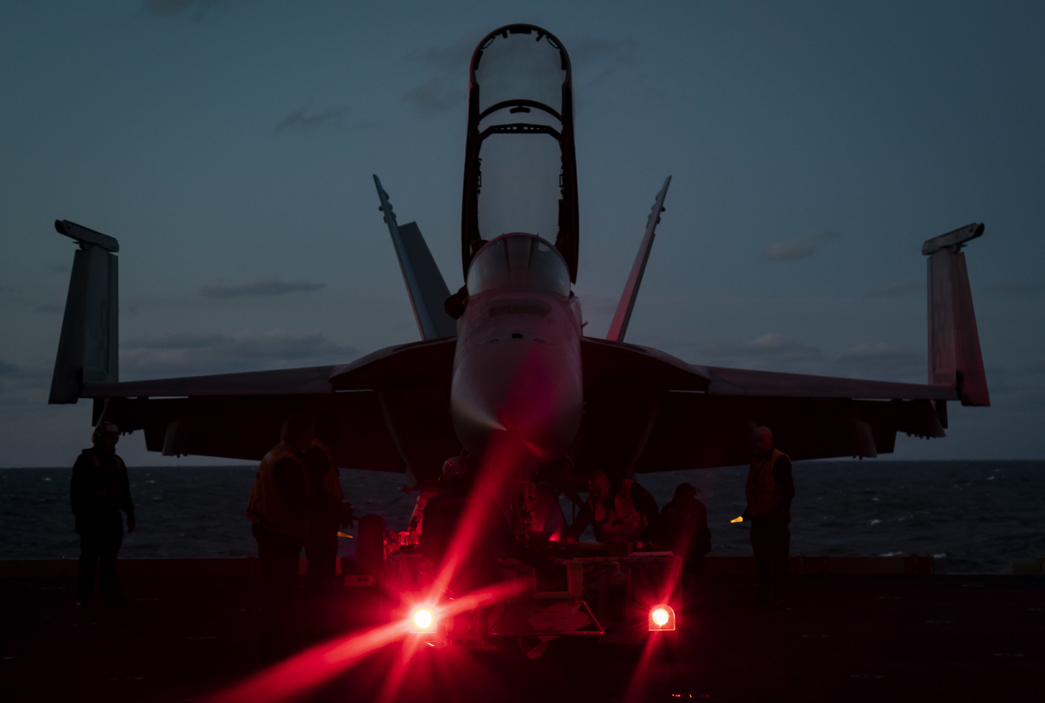 Sailors assigned to the aircraft carrier USS Gerald R. Ford (CVN 78) prepare to move an F/A-18F Super Hornet from an aircraft elevator to the hangar bay on Jan. 23, 2020, in the Atlantic Ocean. (Mass Communication Specialist 3rd Class Connor Loessin/Navy)
