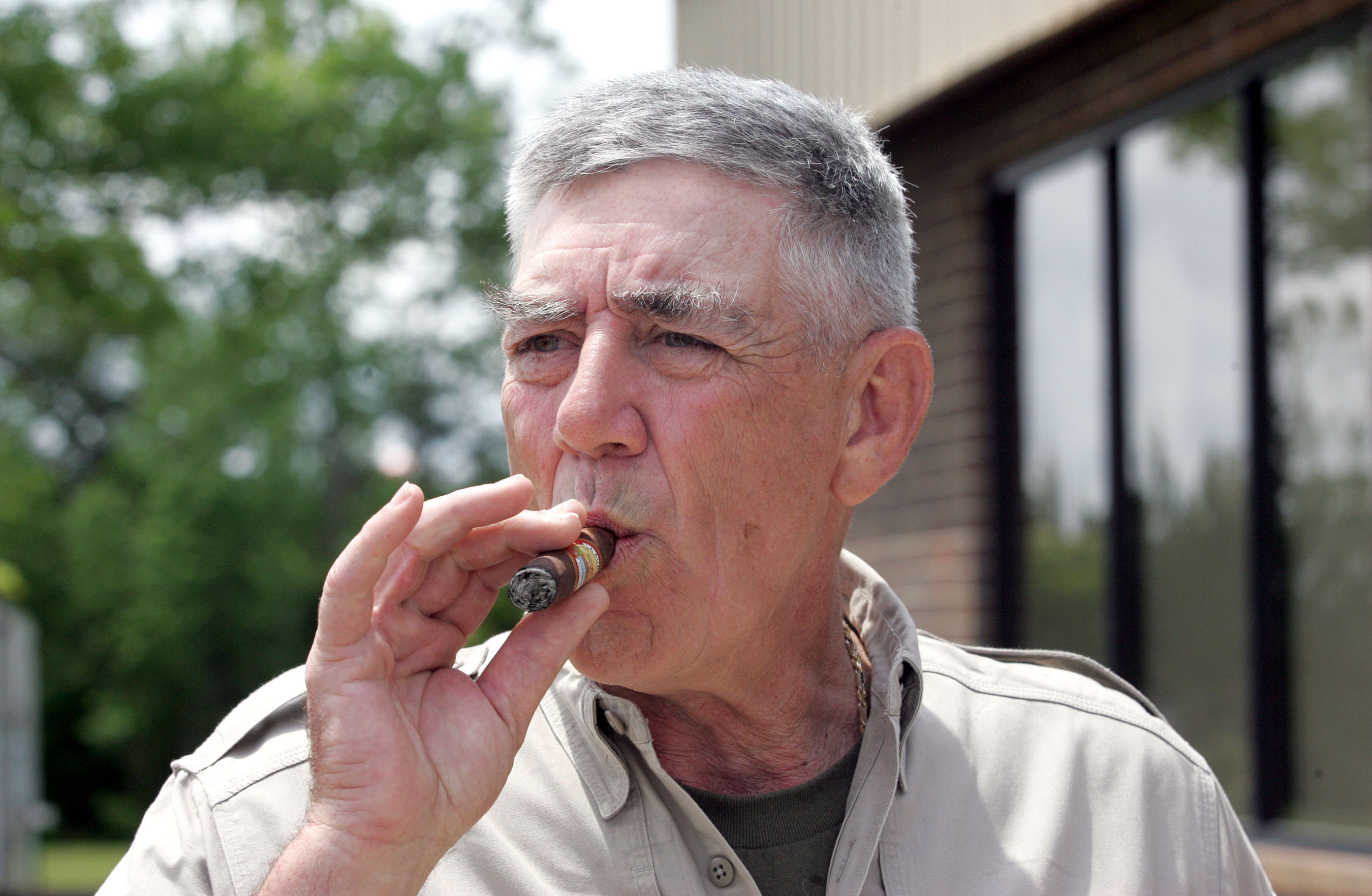 Retired Marine Gunnery Sgt. R. Lee Ermey takes a break for a smoke outside New River Air Station's Staff NCO club, Monday, May 15, 2006, in Jacksonville, N.C. When people meet Ermey, the first thing they realize is his show-stopping turn as a Marine Corps drill instructor in the movie
