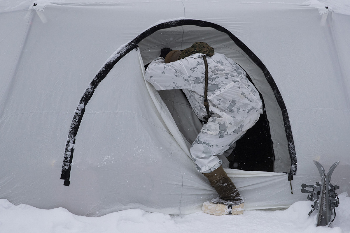 A U.S. Marine walks into a tent during advanced cold-weather training at the Marine Corps Mountain Warfare Training Center Saturday, Feb. 9, 2019, in Bridgeport, Calif. After 17 years of war against Taliban and al-Qaida-linked insurgents, the military is shifting its focus to better prepare for great-power competition with Russia and China, and against unpredictable foes such as North Korea and Iran. (Jae C. Hong/AP)