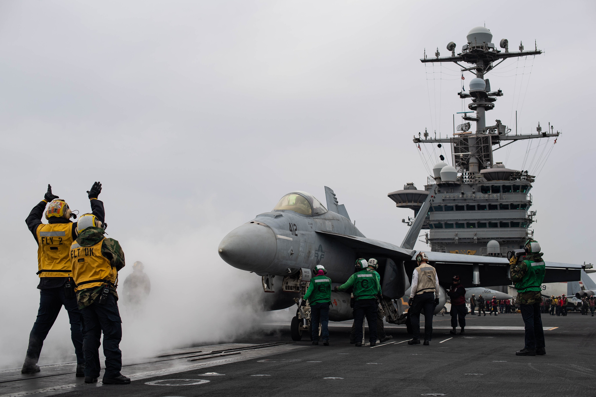 Sailors attach an F/A-18E Super Hornet to a steam-powered catapult on the flight deck of the aircraft carrier USS John C. Stennis (CVN 74) on April 22, 2019, in the Mediterranean Sea. (Mass Communication Specialist 3rd Class Grant G. Grady/Navy)