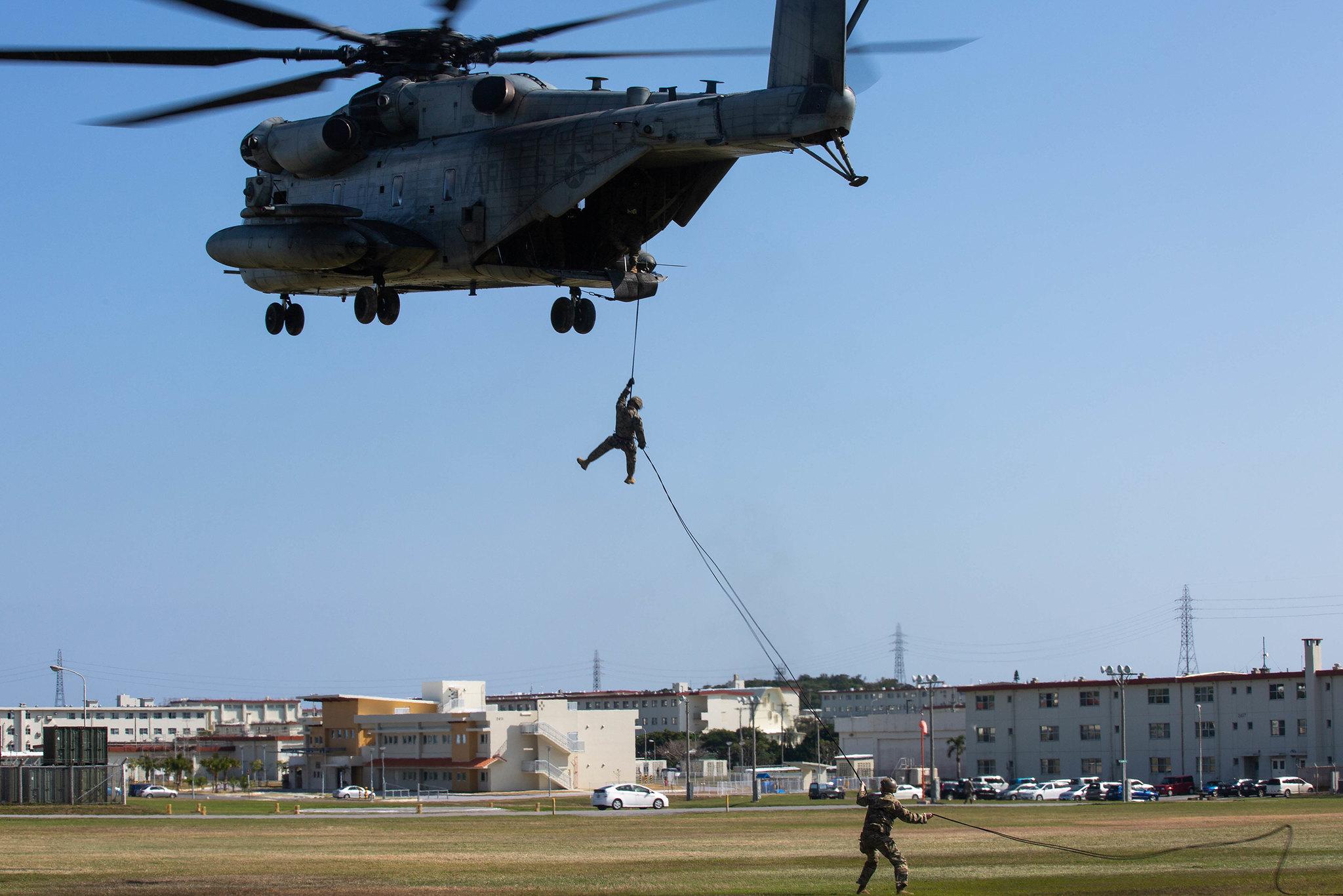 U.S. Marines rappel off a CH-53E Super Stallion helicopter on Camp Hansen, Okinawa, Japan, Jan. 14, 2020. (Lance Cpl. Jackson Dukes/Marine Corps)