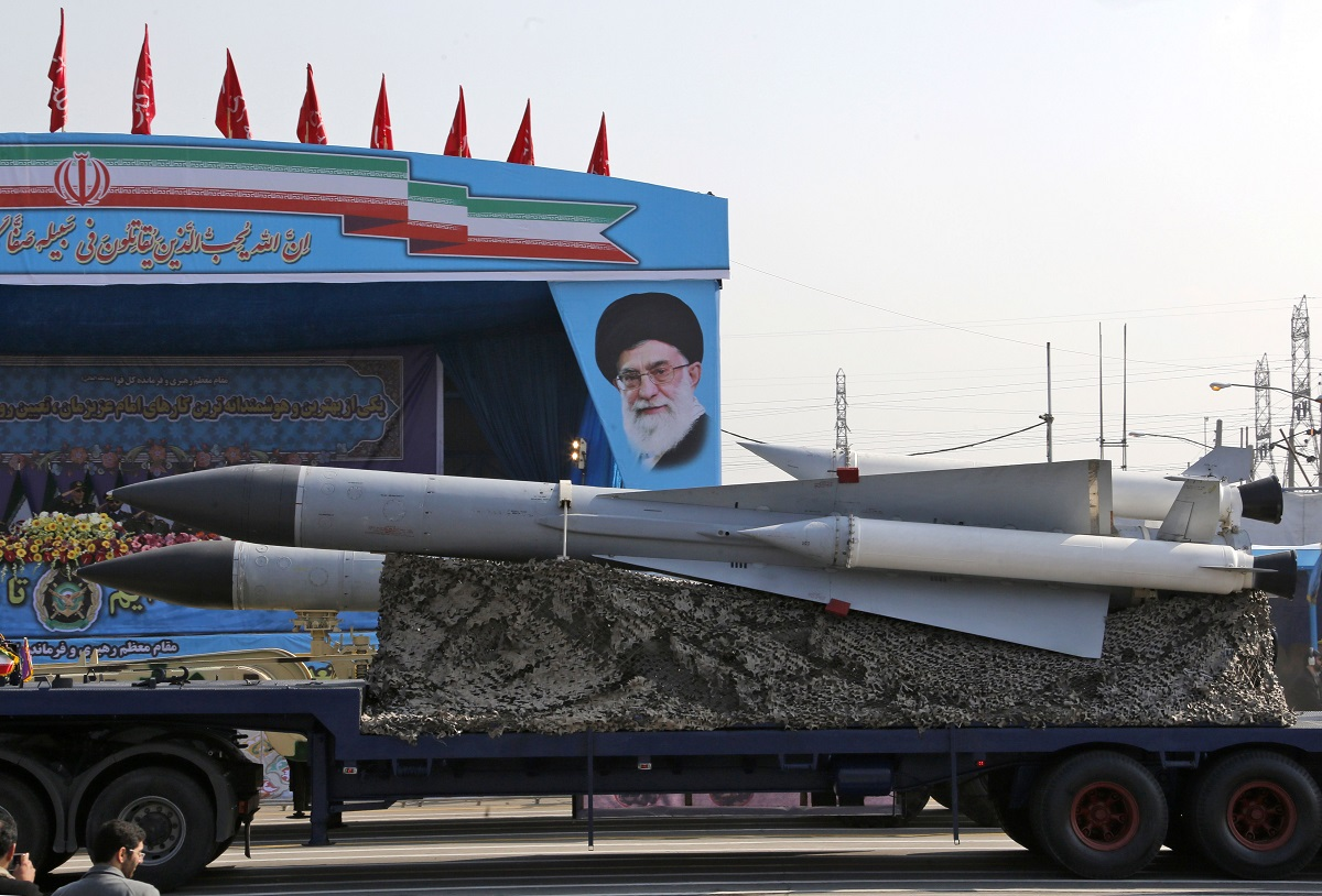 An Iranian military truck carries the S-200 missile defense system past a portrait of Iran's Supreme Leader Ayatollah Ali Khamenei during a parade on the occasion of the country's annual Army Day. (Atta Kenare/AFP via Getty Images)