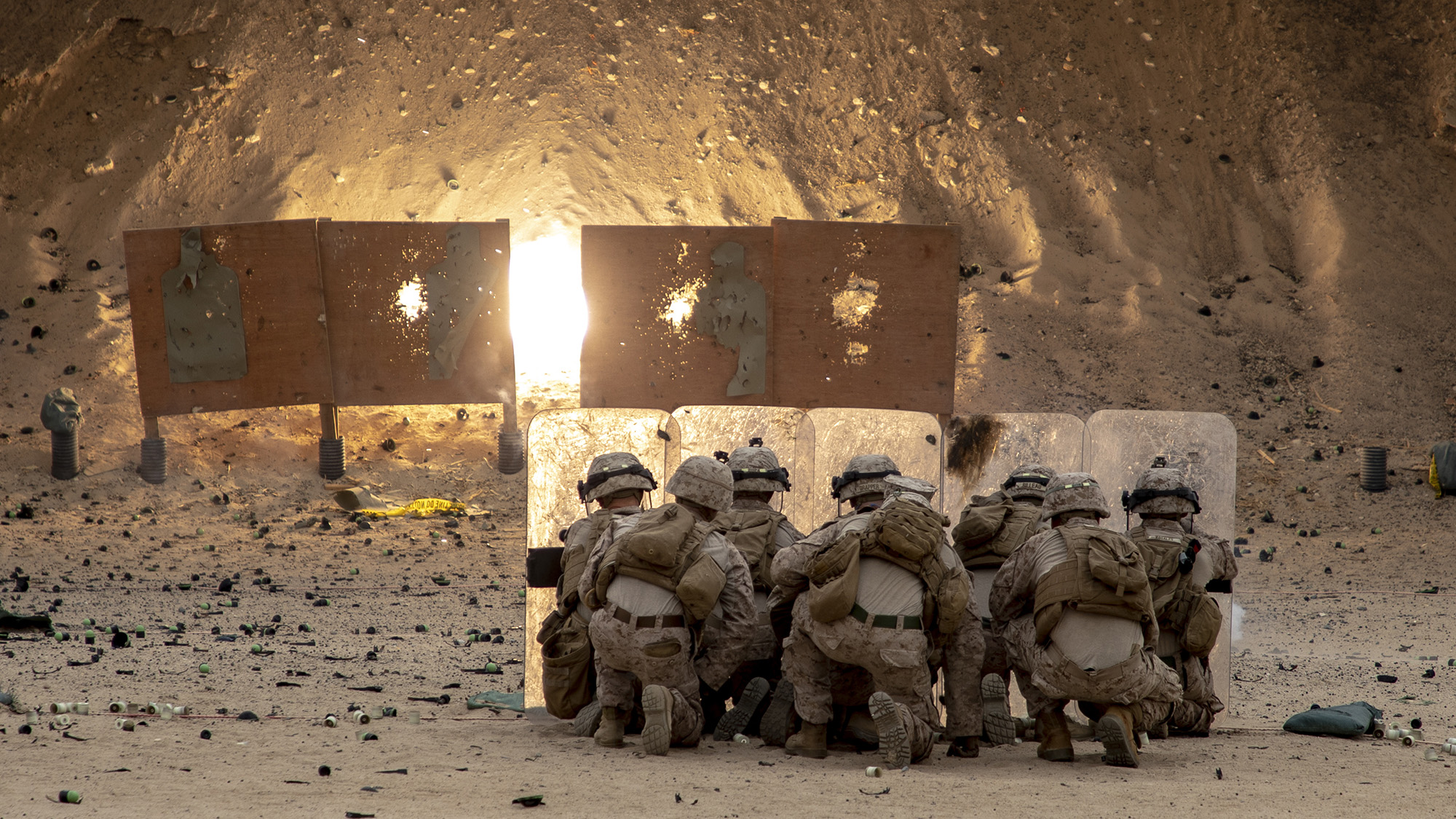 Marines with 2nd Battalion, 7th Marines, assigned to Special Purpose Marine Air-Ground Task Force – Crisis Response – Central Command (SPMAGTF-CR-CC) 19.2, take cover while throwing non-lethal grenades during a non-lethal weapons training exercise on Jan. 18, 2020, in Kuwait. (Sgt. Robert G. Gavaldon/Marine Corps)