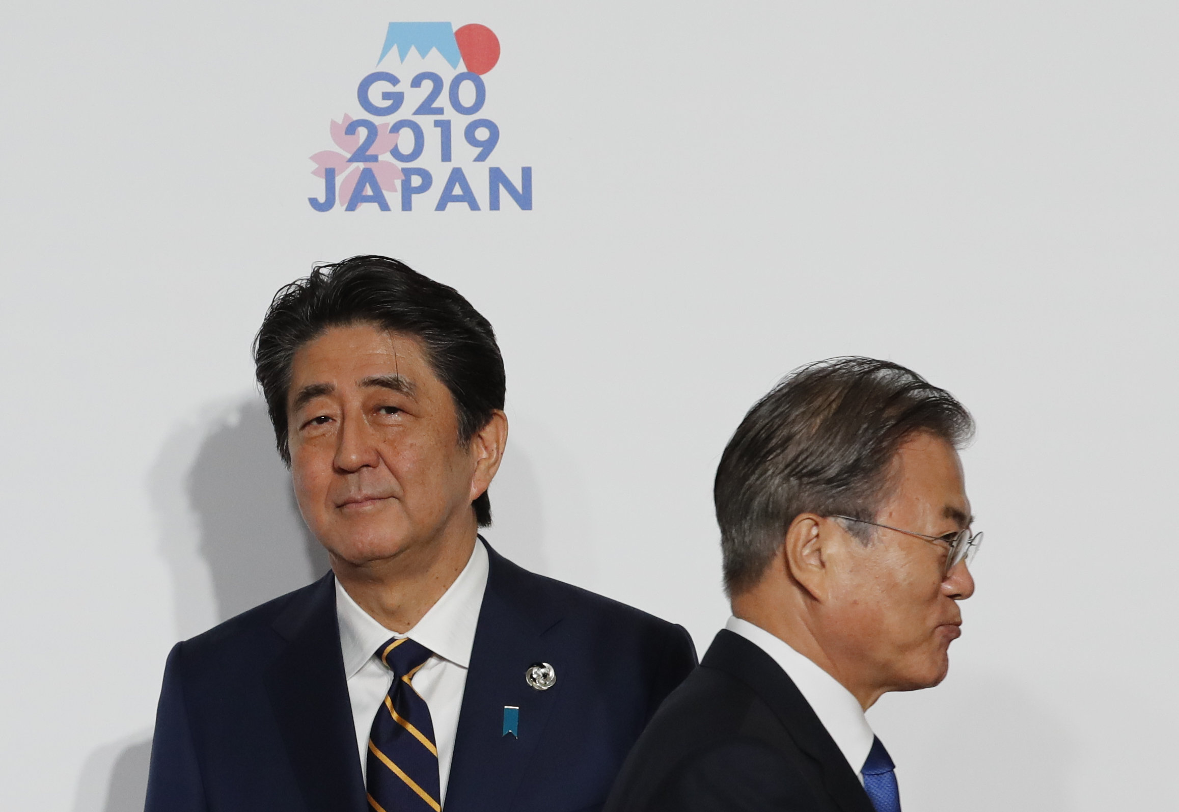 South Korean President Moon Jae-In, right, and Japanese Prime Minister Shinzo Abe prepare to take part in a photo session at the G20 summit on June 28, 2019, in Osaka, Japan. (Kim Kyung-Hoon/Getty Images)