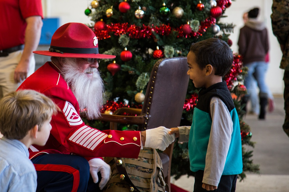 Gunny Claus greets children at a Christmas party host by Marine Aerial Refueler transport Squadron (VMGR) 252 at Marine Corps Air Station Cherry Point, N.C., Dec. 1, 2017. The Marines and family of VMGR-252 had the celebration to enjoy the holiday season and build unit cohesion. (Lance Cpl. Ethan Pumphret/Marine Corps)
