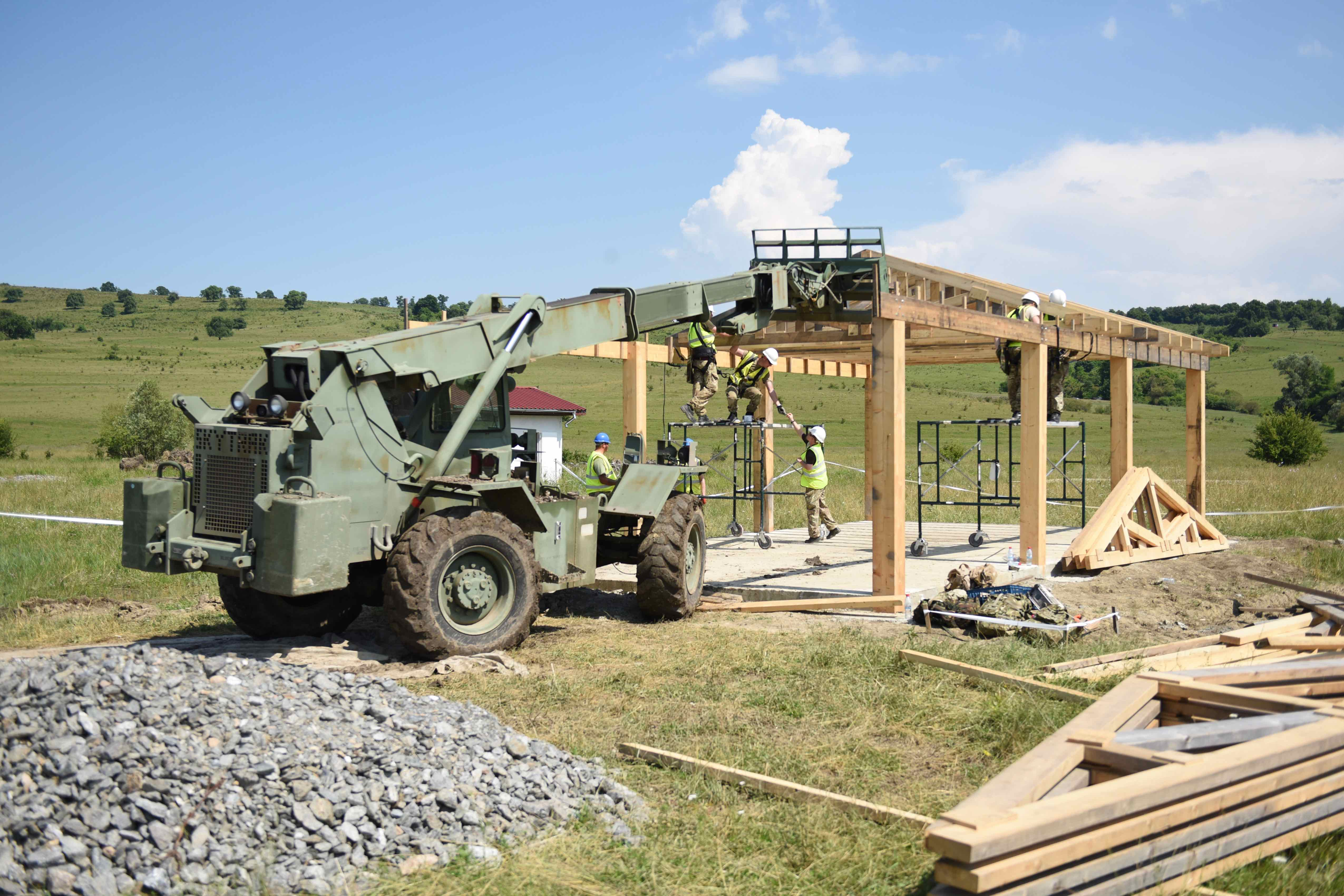 The multipurpose shelter, which was almost fully constructed by July 14, is being assembled by soldiers from the U.K. and Romania. British soldiers specialized in building structures during Resolute Castle. Building training ranges on the Romanian site will have a lasting impact, by providing both new state-of-the-art facilities as well as training experiences for engineers assigned to the building. (Jen Judson/Staff)