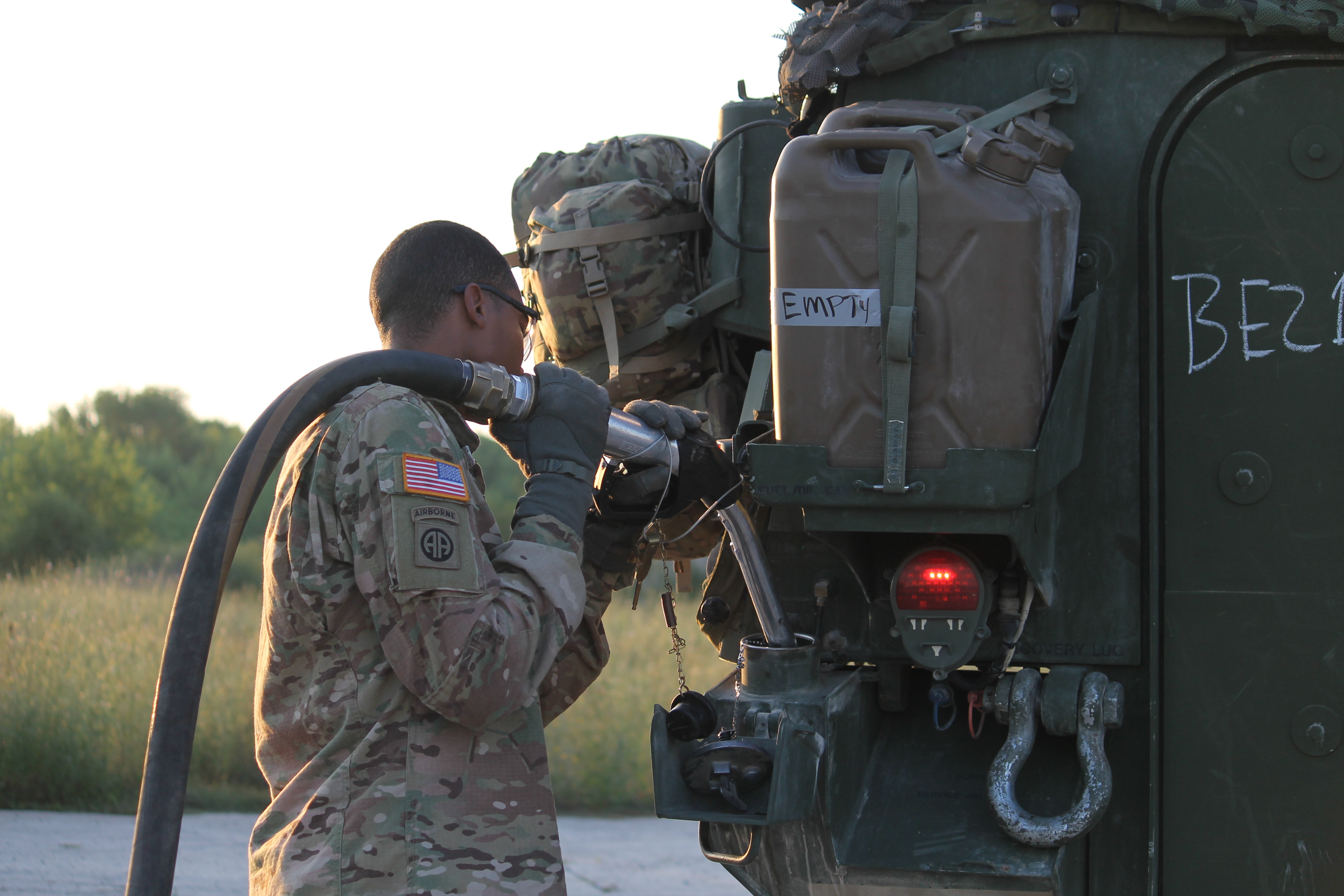 A soldier refuels the U.S. Stryker, preparing the vehicle to head over to the seized airfield, where the 173rd awaits support. (Jen Judson/Staff)