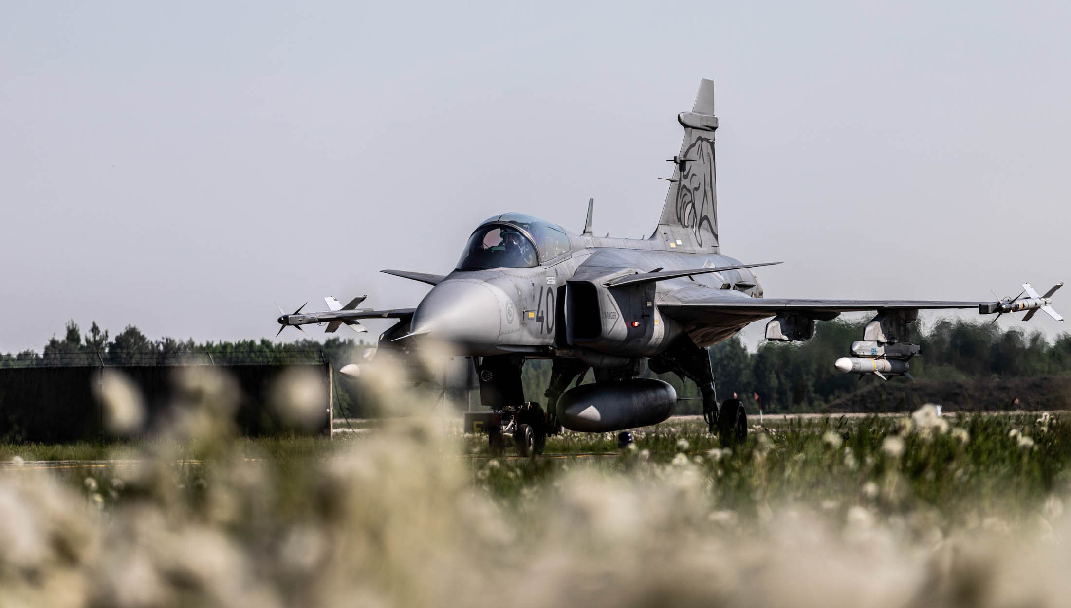 A Hungarian Air Force Gripen jet taxis after launching a training scramble in support of NATO's Baltic-based air-policing mission in May 2019. (NATO)