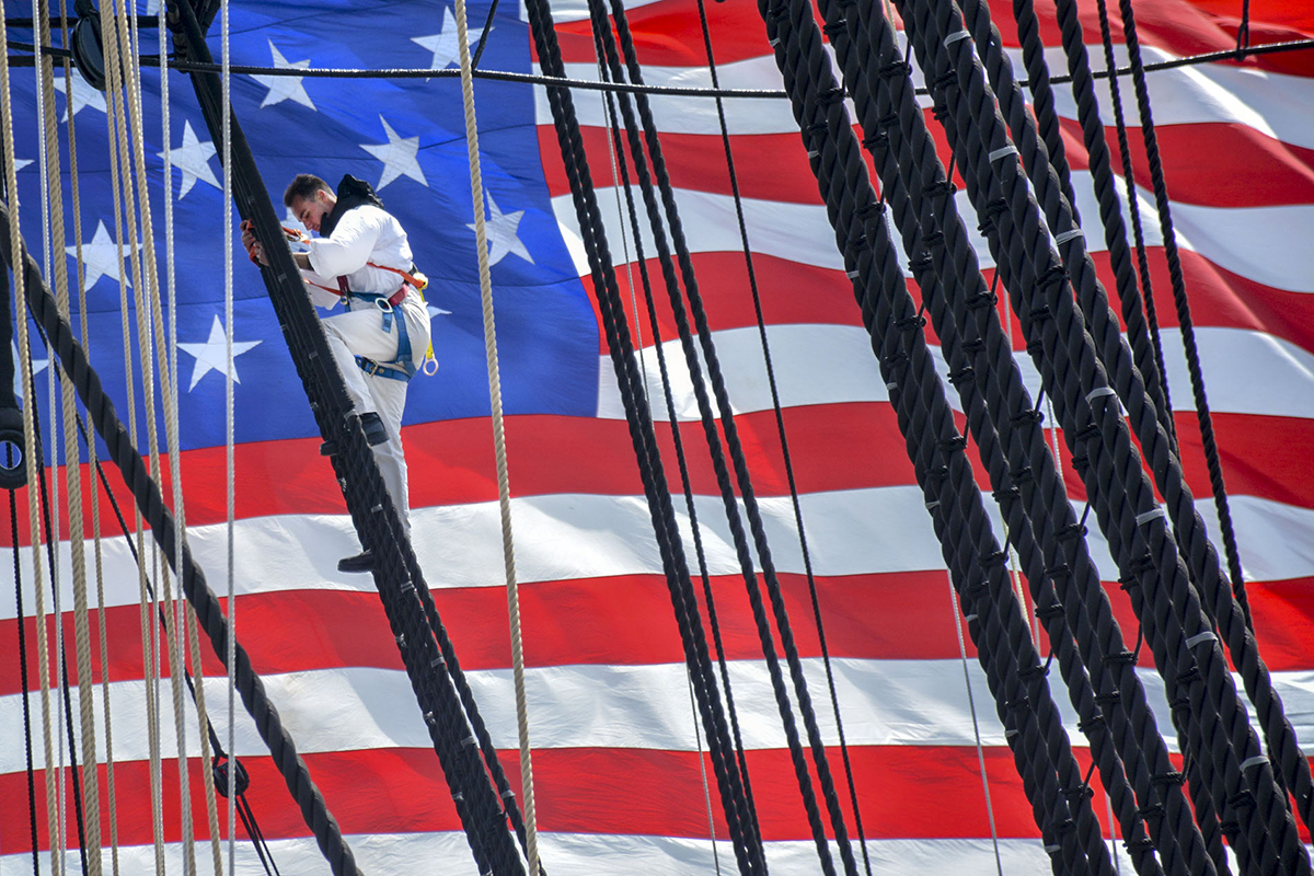 BOSTON (May 18, 2018) Fireman Gabriel Lupo, assigned to USS Constitution, climbs the ship's mizzenmast during 'Old Ironsides' underway commemorating the Vietnam War. In coordination with the United States of America Vietnam War Commemoration, the crew of USS Constitution hosted Vietnam veterans onboard as a thank you for their years of service and sacrifice for their country. (MC3 Casey Scoular/Navy)