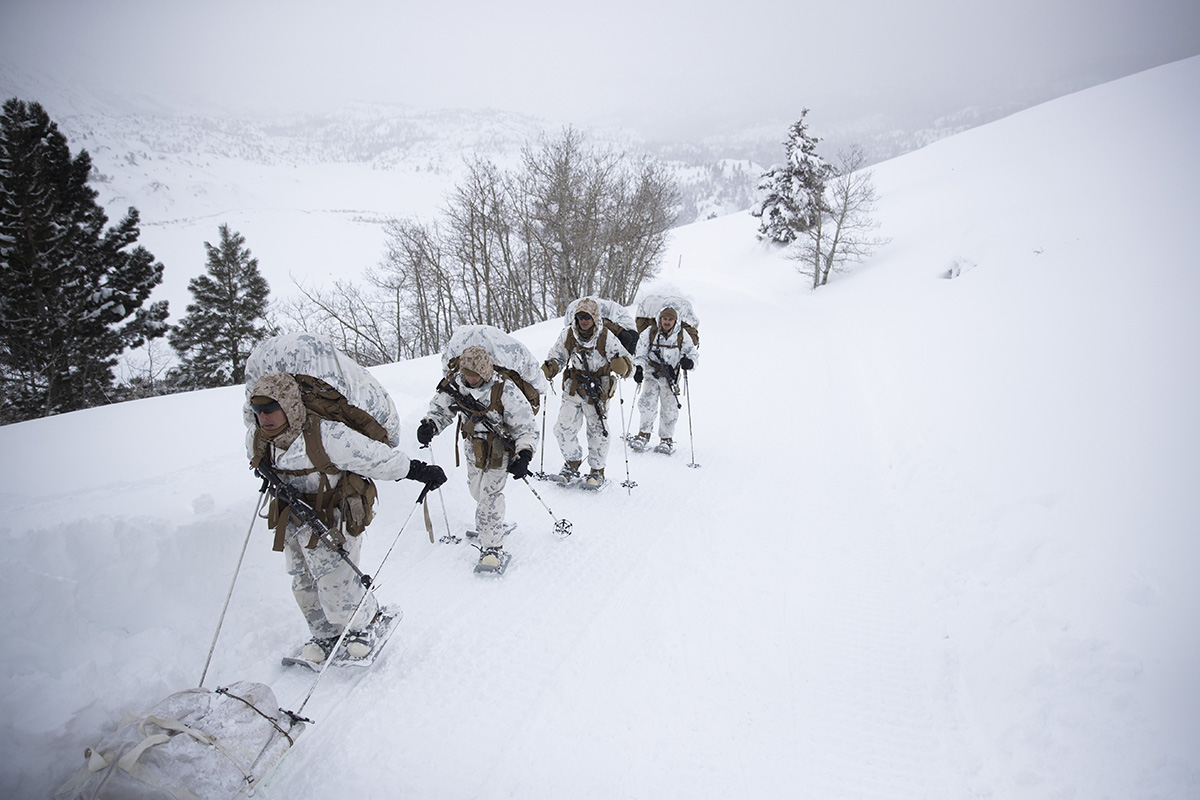A group of U.S. Marines walk along a snow-covered trail during their advanced cold-weather training at the Marine Corps Mountain Warfare Training Center Sunday, Feb. 10, 2019, in Bridgeport, Calif. After 17 years of war against Taliban and al-Qaida-linked insurgents, the military is shifting its focus to better prepare for great-power competition with Russia and China, and against unpredictable foes such as North Korea and Iran. (Jae C. Hong/AP)