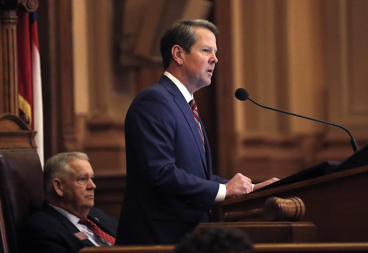 Georgia Gov. Brian Kemp, right, speaks to members of the Georgia House as House Speaker David Ralston looks on during the final 2019 legislative session at the State Capitol Tuesday, April 2, 2019, in Atlanta. (John Bazemore/AP)
