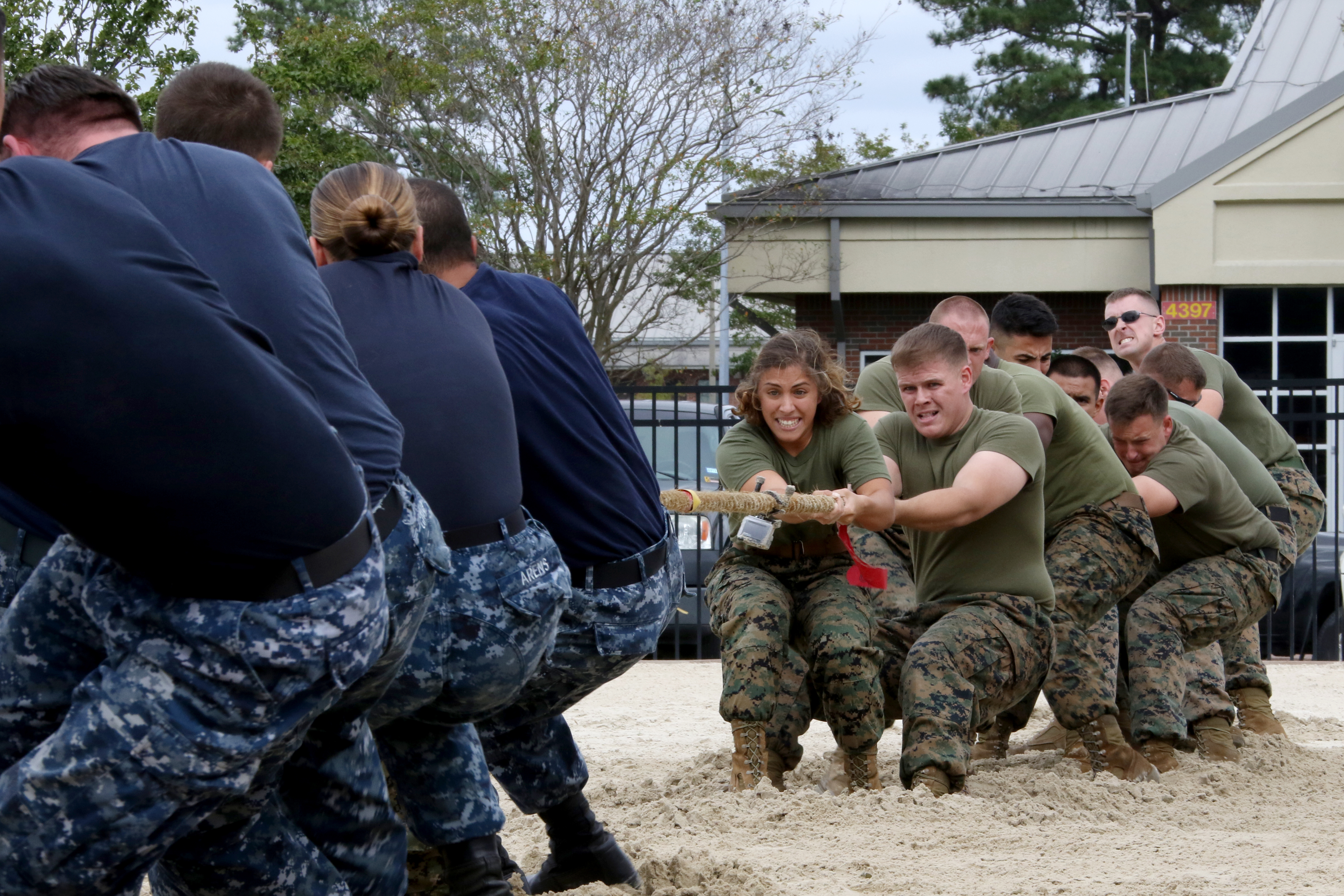 Sailors from the Naval Health Clinic and Marines from Marine Aerial Refueler Transport Squadron 252 battle it out in one of the early contests during the 2017 Combined Federal Campaign Tug-of-War Tournament at Marine Corps Air Station Cherry Point, N.C., Oct. 13, 2017. (Cpl. Jason Jimenez/Marine Corps)