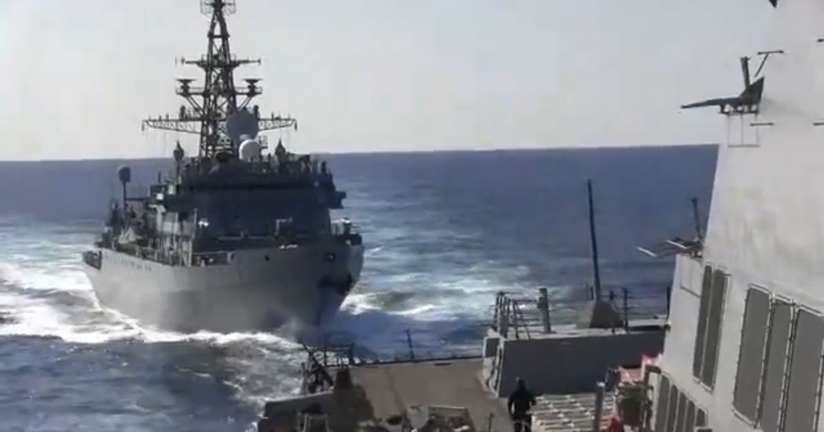 This photo provided by the U.S. 5th Fleet, shows a Russian Navy ship approaching an American warship in the North Arabian Sea, on Thursday, Jan. 9, 2020. A spokesman for U.S. 5th Fleet said Friday that the USS Farragut was conducting routine operations Thursday and sounded five short blasts to warn the Russian ship of a possible collision. He said the USS Farragut asked the Russian ship to change course and the ship initially refused but ultimately moved away. Even though the Russian ship moved away, the Navy spokesman said the delay in shifting course Òincreased the risk of collision.ÓÊ (U.S. 5th Fleet via AP)