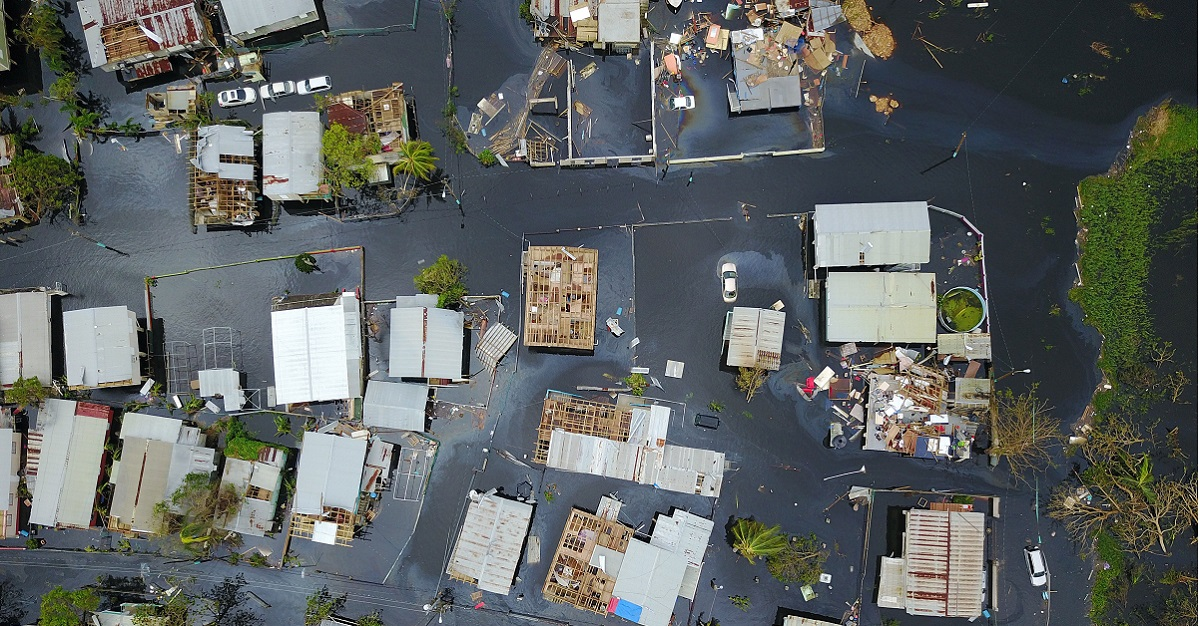 An aerial view of the flooded neighborhood of Juana Matos in the aftermath of Hurricane Maria in Catano, Puerto Rico on Sept. 22, 2017. Six months after Hurricane Maria hit the island on Sept. 20, many remain without power. (Ricardo Arduengo/AFP/Getty Images)