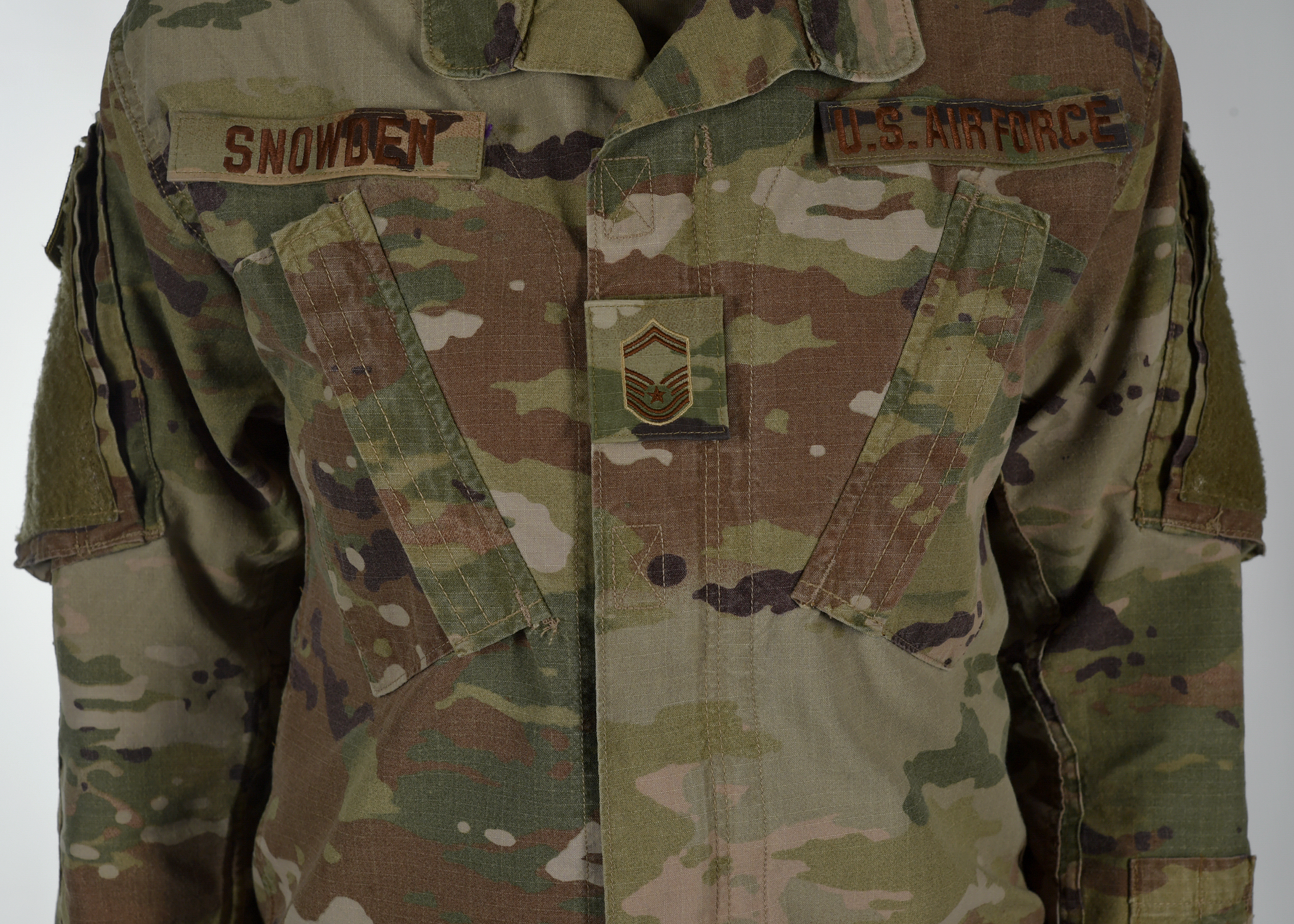 Airmen will wear their rank in the middle of their chest ― instead of on their sleeves or collars ― and the uniform will have velcro pockets on the chest. (Air Force)