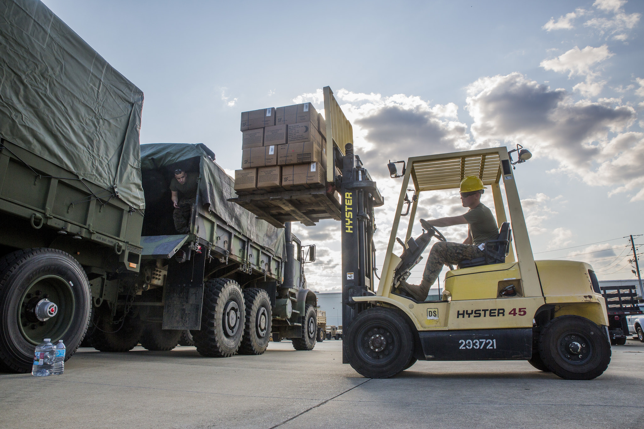 Marines from 3rd Force Reconnaissance Company, 4th Marine Division, Marine Forces Reserve, load a spare tire onto an MTVR 7-ton truck at the Alabama Army National Guard Fort Whiting Armory in Mobile, Ala., Sept. 9, 2017, in preparation of rescue missions following Hurricane Irma. (Lance Cpl. Niles Lee/Marine Corps)